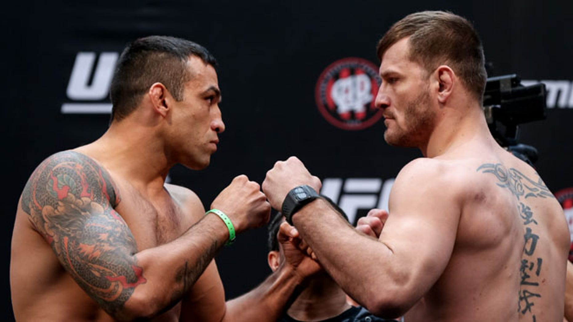 CURITIBA, BRAZIL - MAY 13:  (L-R) Opponents Fabricio Werdum of Brazil and Stipe Miocic of the United States face off during the UFC 198 weigh-in at Arena da Baixada stadium on May 13, 2016 in Curitiba, Brazil. (Photo by Buda Mendes/Getty Images)