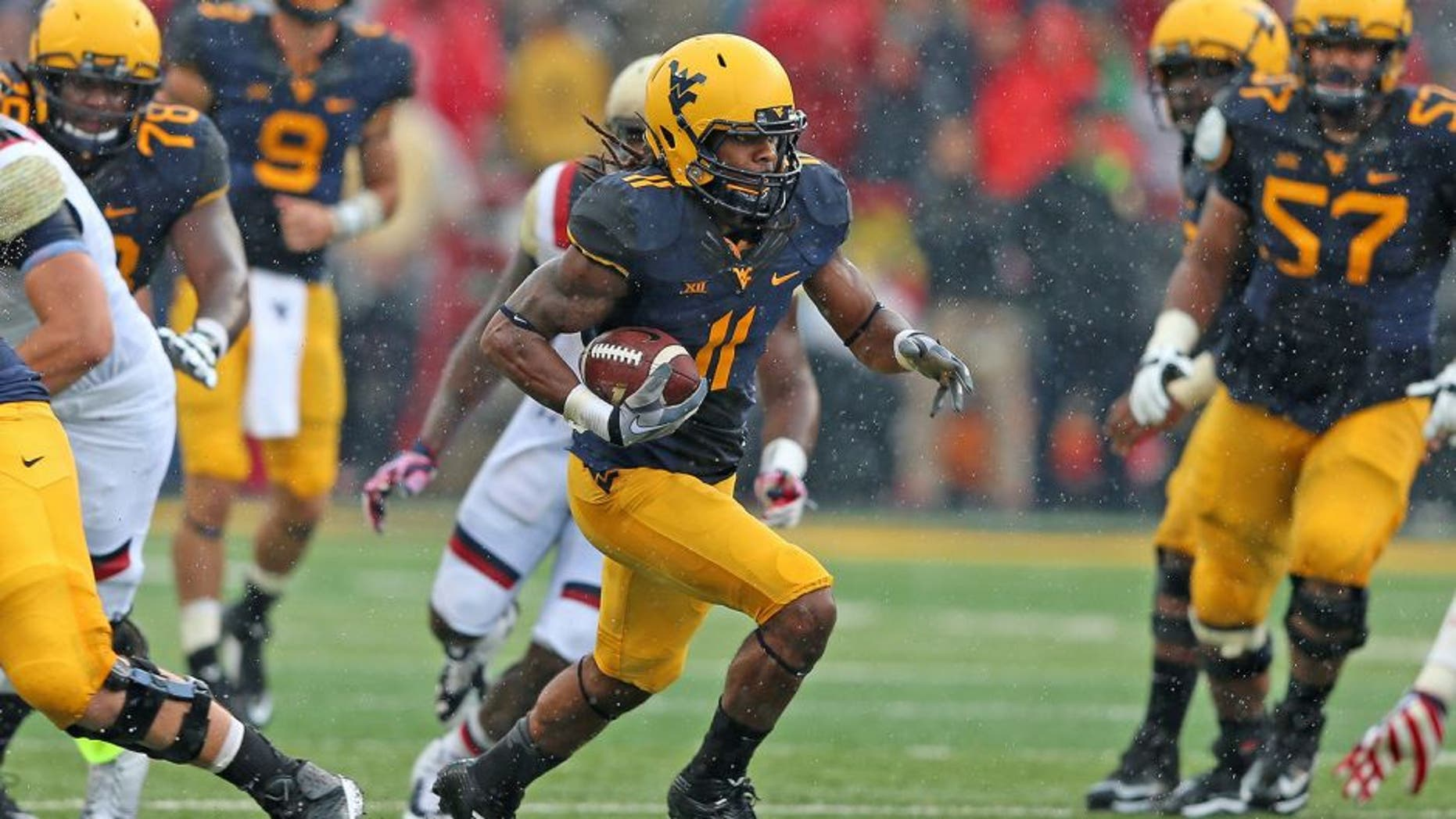 Sep 13, 2014; College Park, MD, USA; West Virginia Mountaineers wide receiver Kevin White (11) gains yards after his catch against the Maryland Terrapins at Byrd Stadium. Mandatory Credit: Mitch Stringer-USA TODAY Sports