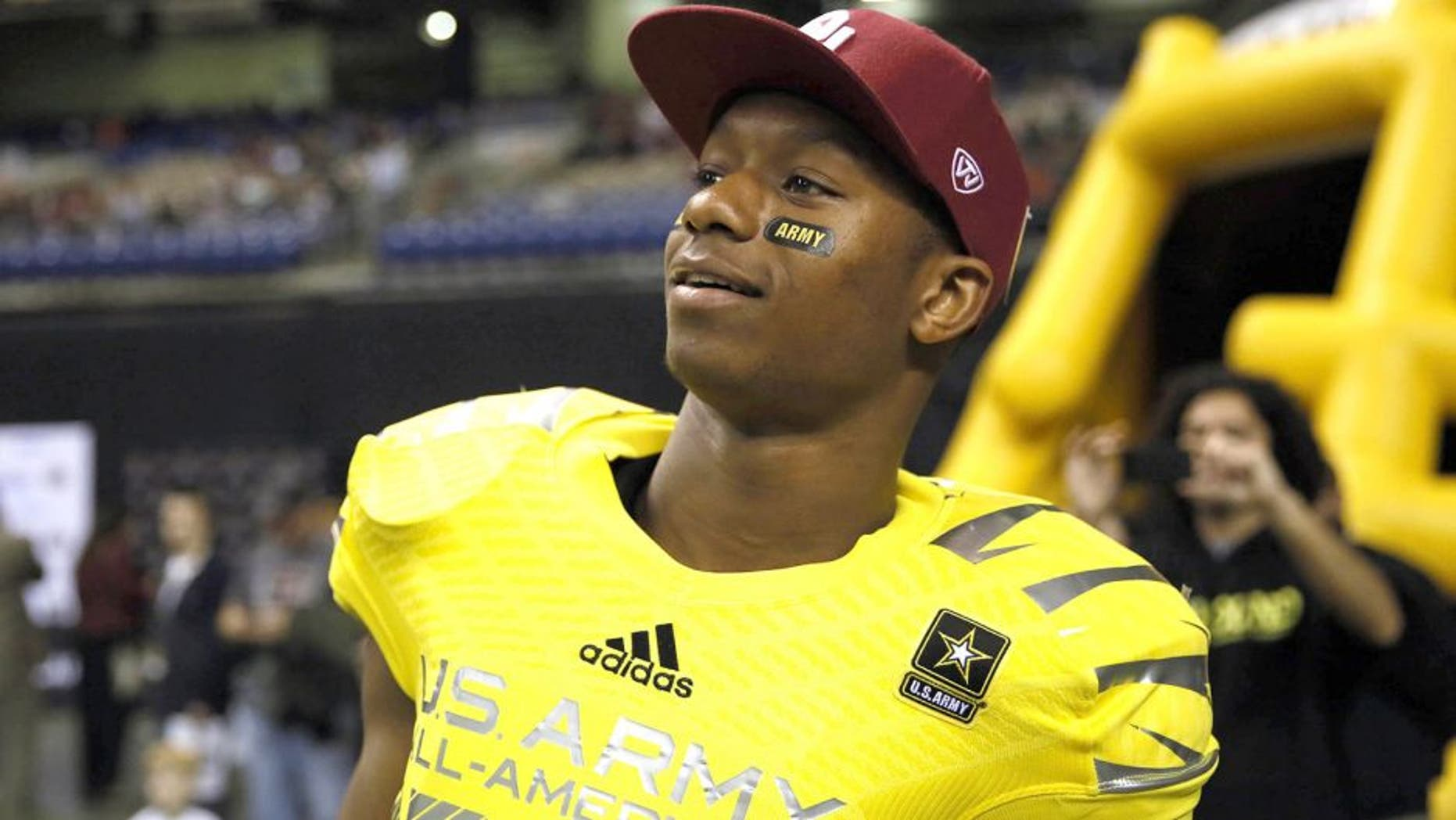 Jan 4, 2014; San Antonio, TX, USA; West running back Joe Mixon (28) watches from the sidelines during U.S. Army All-American Bowl high school football game at the Alamodome. The West won 28-6. Mandatory Credit: Soobum Im-USA TODAY Sports