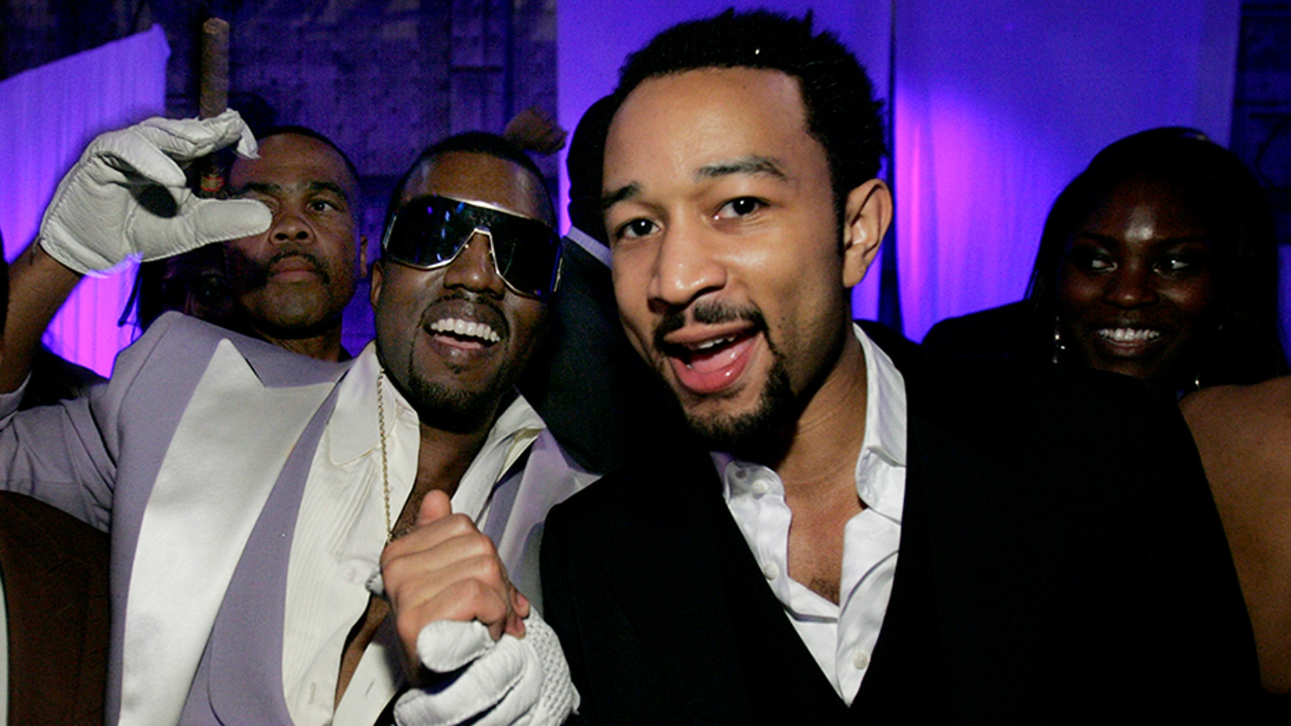 Kanye West accused John Legend of trying to manipulate his free thought.
