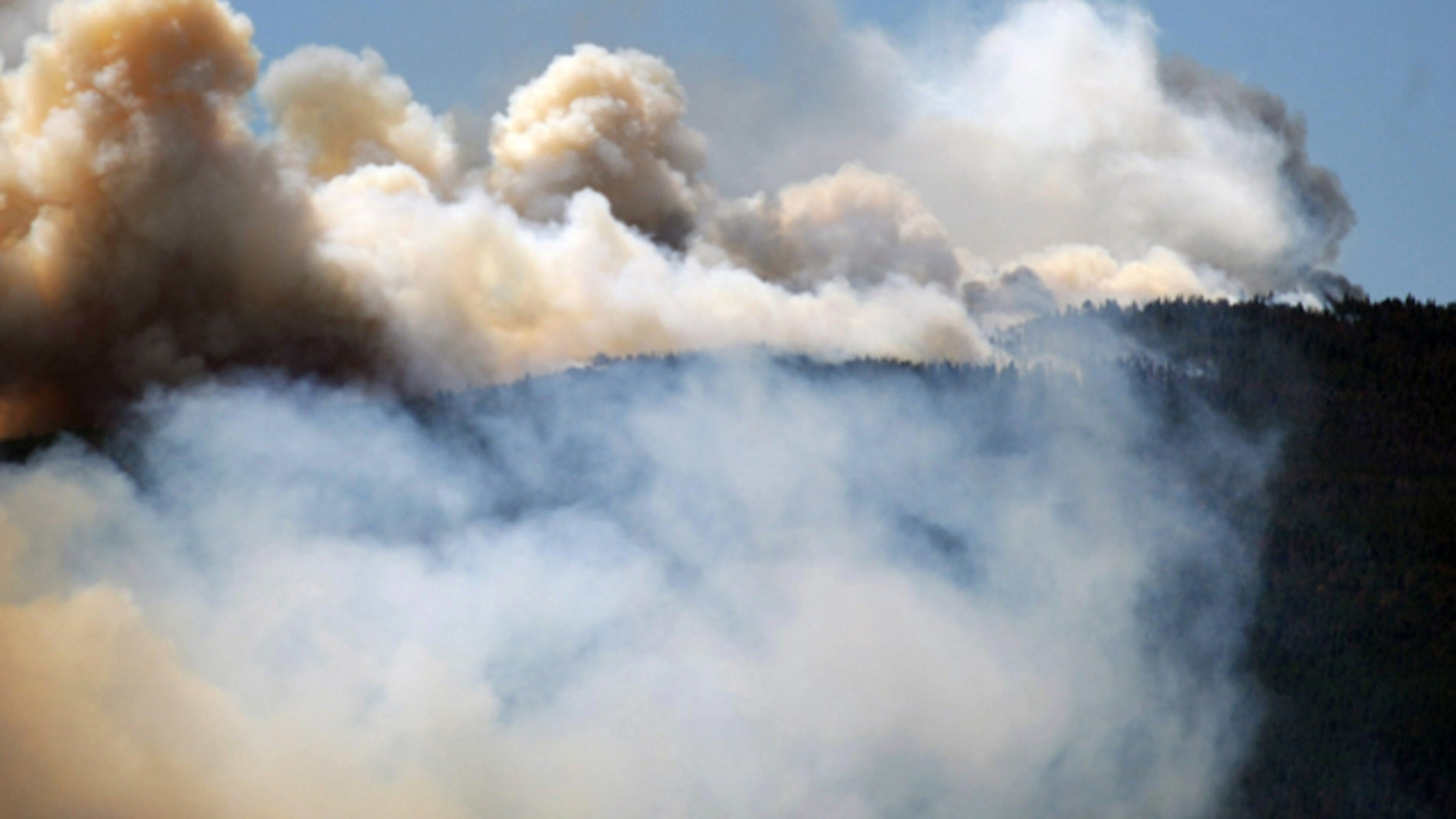 June 12, 2012: Smoke billows from a wildfire burning west of Fort Collins, Colo.