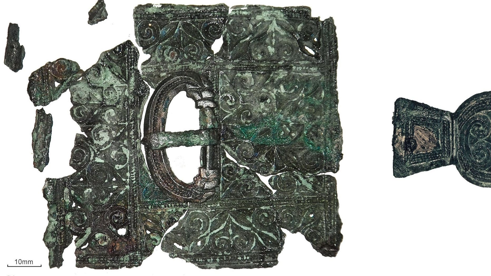The Late Roman belt — including a buckle, belt plate and strap end — that researchers found in skeleton 23.