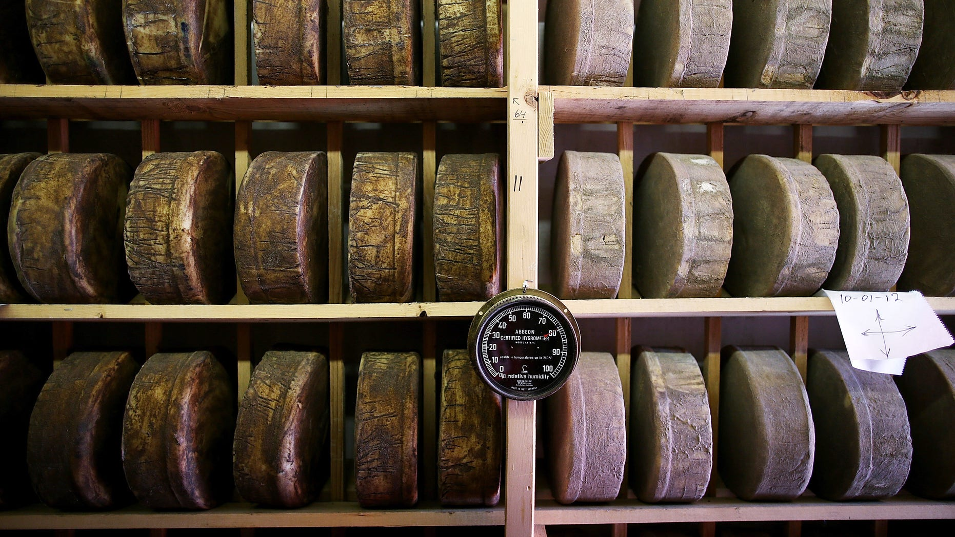 SONOMA, CA - JUNE 10:  Wheels of jack cheese age on wooden racks in a cooler at Vella Cheese on June 10, 2014 in Sonoma, California. The Food and Drug Administration (FDA) has issued an executive decree to ban the use of wooden boards to age cheese, a move that could be a huge blow to artisan cheesamkers who use wooden racks to age their non-processed cheese.  (Photo by Justin Sullivan/Getty Images)