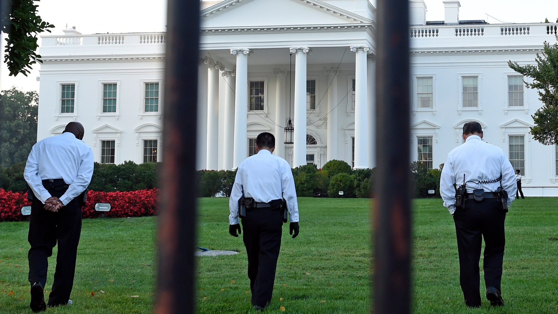 Sept. 20, 2014: Uniformed Secret Service officers walk along the lawn on the North side of the White House in Washington.