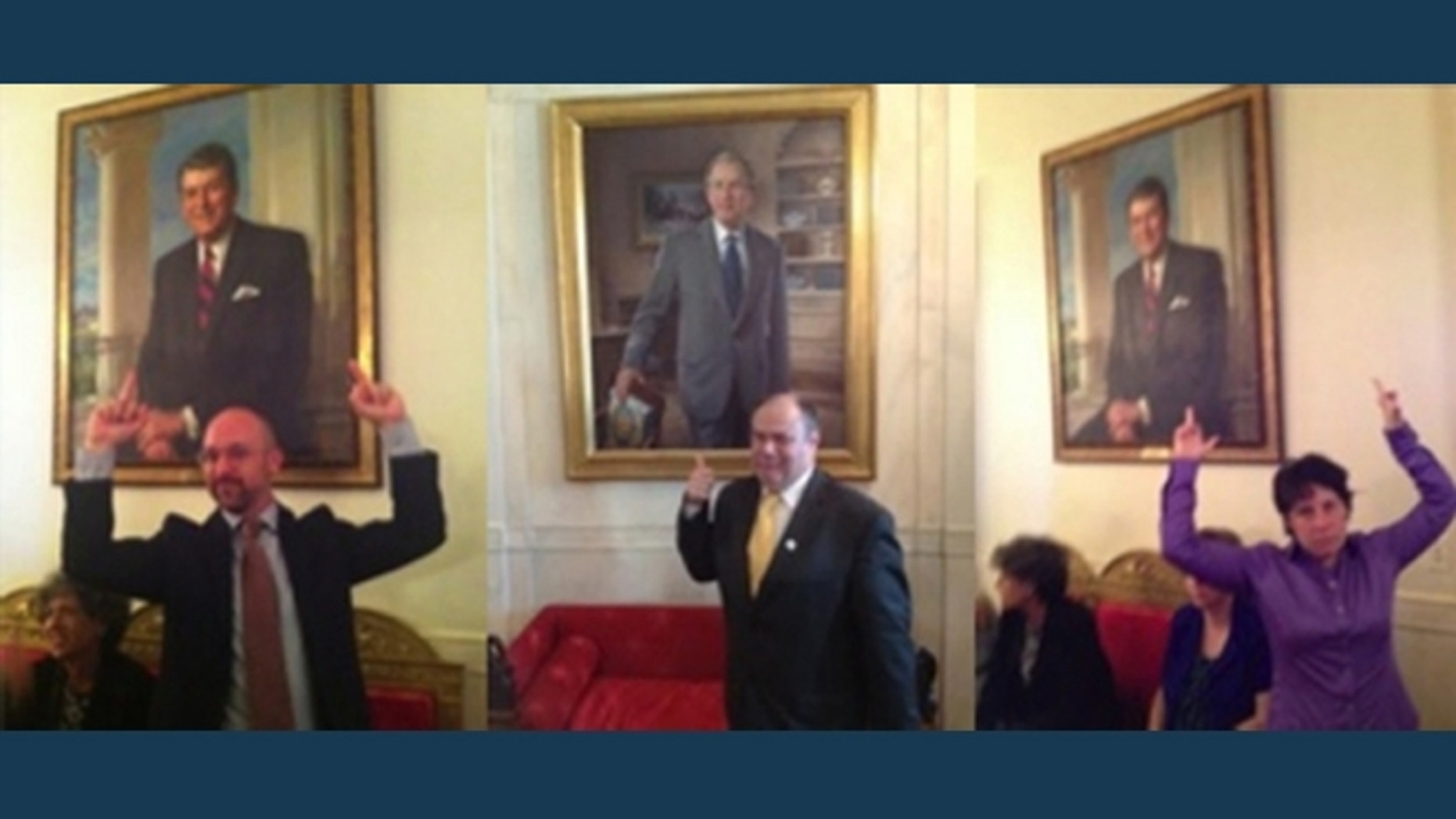 White House guests Zoe Strauss, right, and Matty Hart, left, are seen flipping off a portrait of Ronald Reagan on June 15, 2012. Philadelphia publisher Mark Segal, center, is shown giving a thumbs-up.