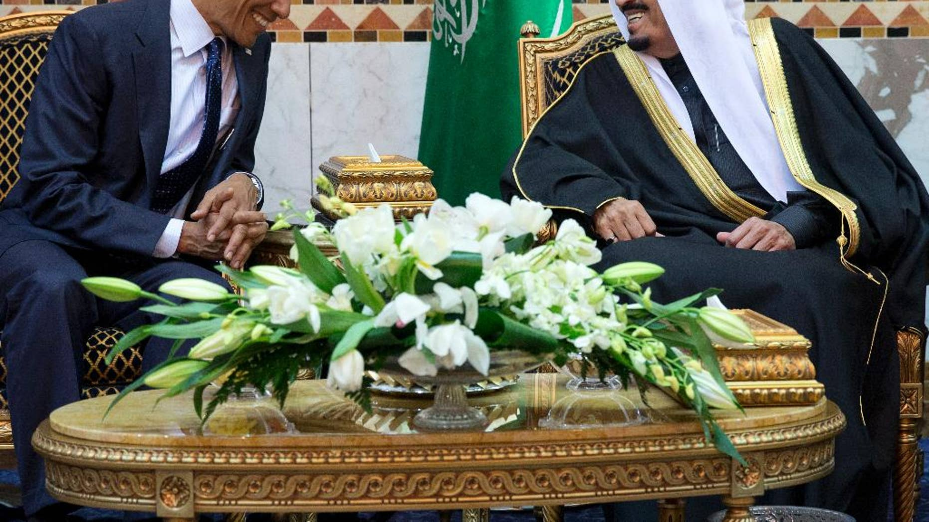 FILE - In this Jan. 27, 2015 file photo, President Barack Obama meets Saudi Arabian King Salman in Riyadh, Saudi Arabia. The Obama administration is greeting King Salman of Saudi Arabia with assurances that a nuclear deal with Iran also comes with the necessary resources to help check its regional ambitions. (AP Photo/Carolyn Kaster, File)