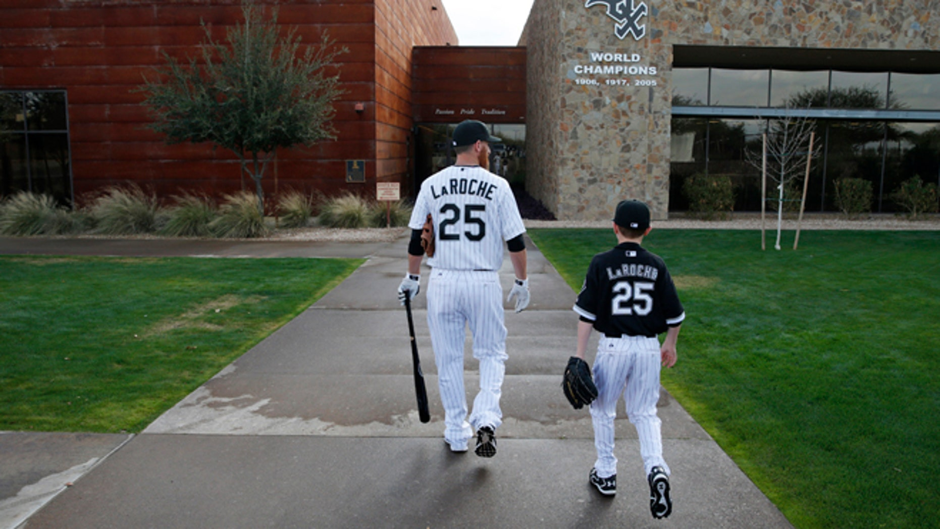 Chicago White Sox's Adam LaRoche, left, and his son Drake walk to the White Sox's clubhouse.