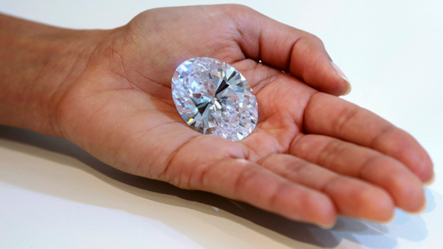 Sept. 4, 2013: A 118-carat white diamond is on display at Sotheby's, a New York auction house.