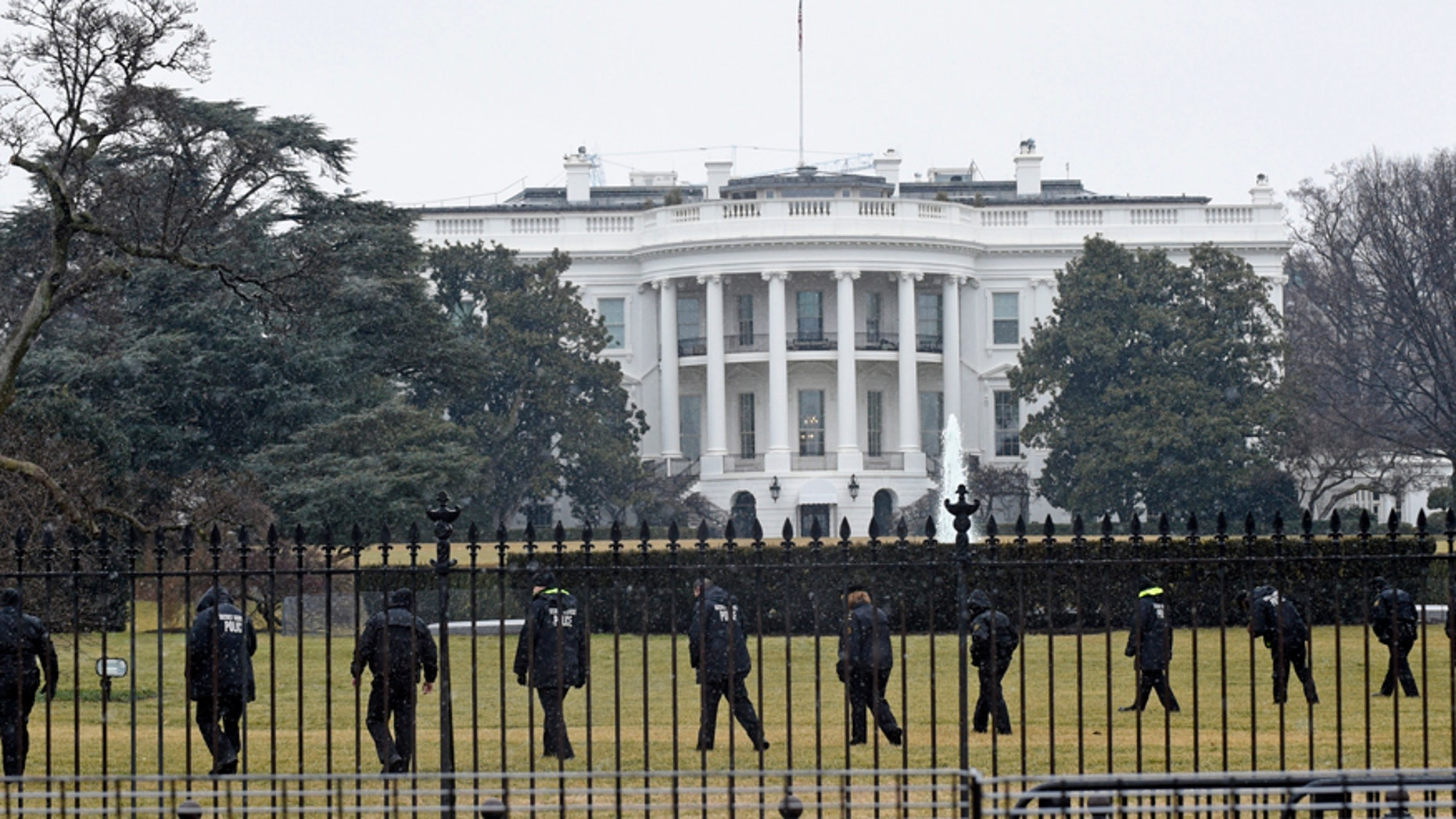 Secret Service officers search the south grounds of the White House in Washington, Monday, Jan. 26, 2015.