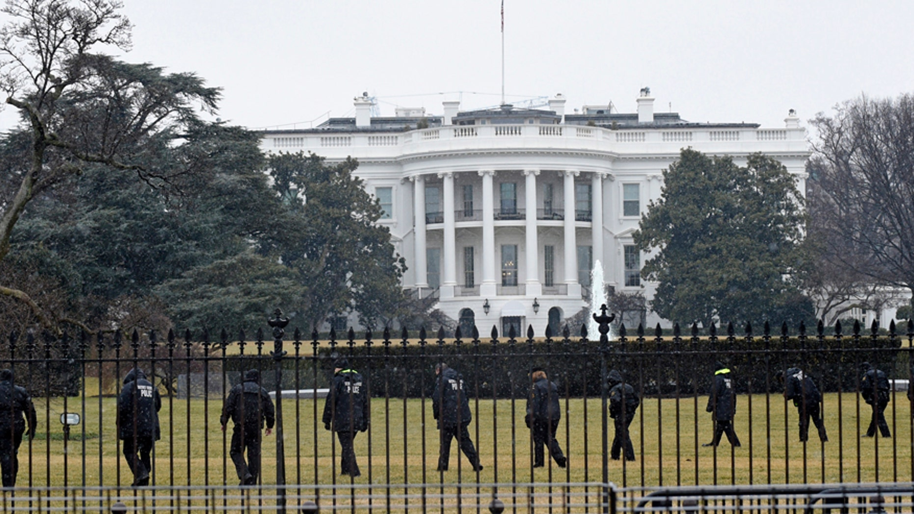Secret Service officers search the south grounds of the White House in Washington after the January, 2015 drone incident.