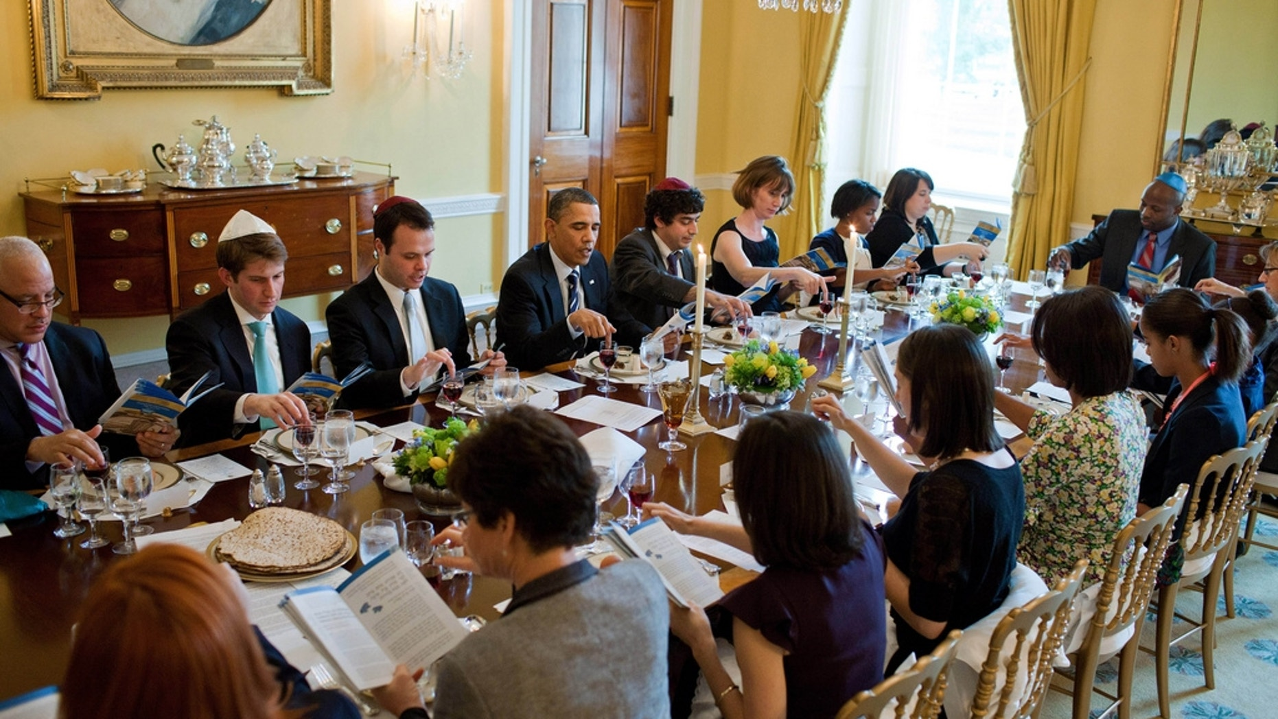 President Barack Obama and First Lady Michelle Obama mark the beginning of Passover with a Seder in the Old Family Dining Room of the White House, April 18, 2011. (Official White House Photo by Pete Souza)