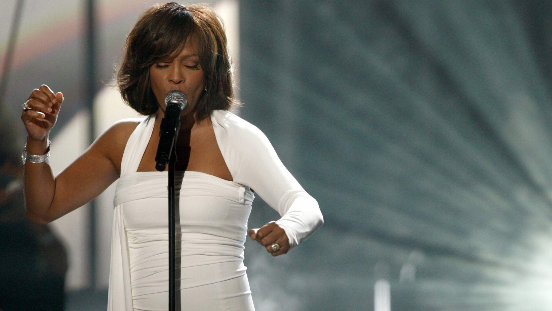 In this Nov. 22, 2009, file photo, Whitney Houston performs at the 37th Annual American Music Awards in Los Angeles. Houston died Saturday, Feb. 11, 2012, she was 48. (AP Photo/Matt Sayles)