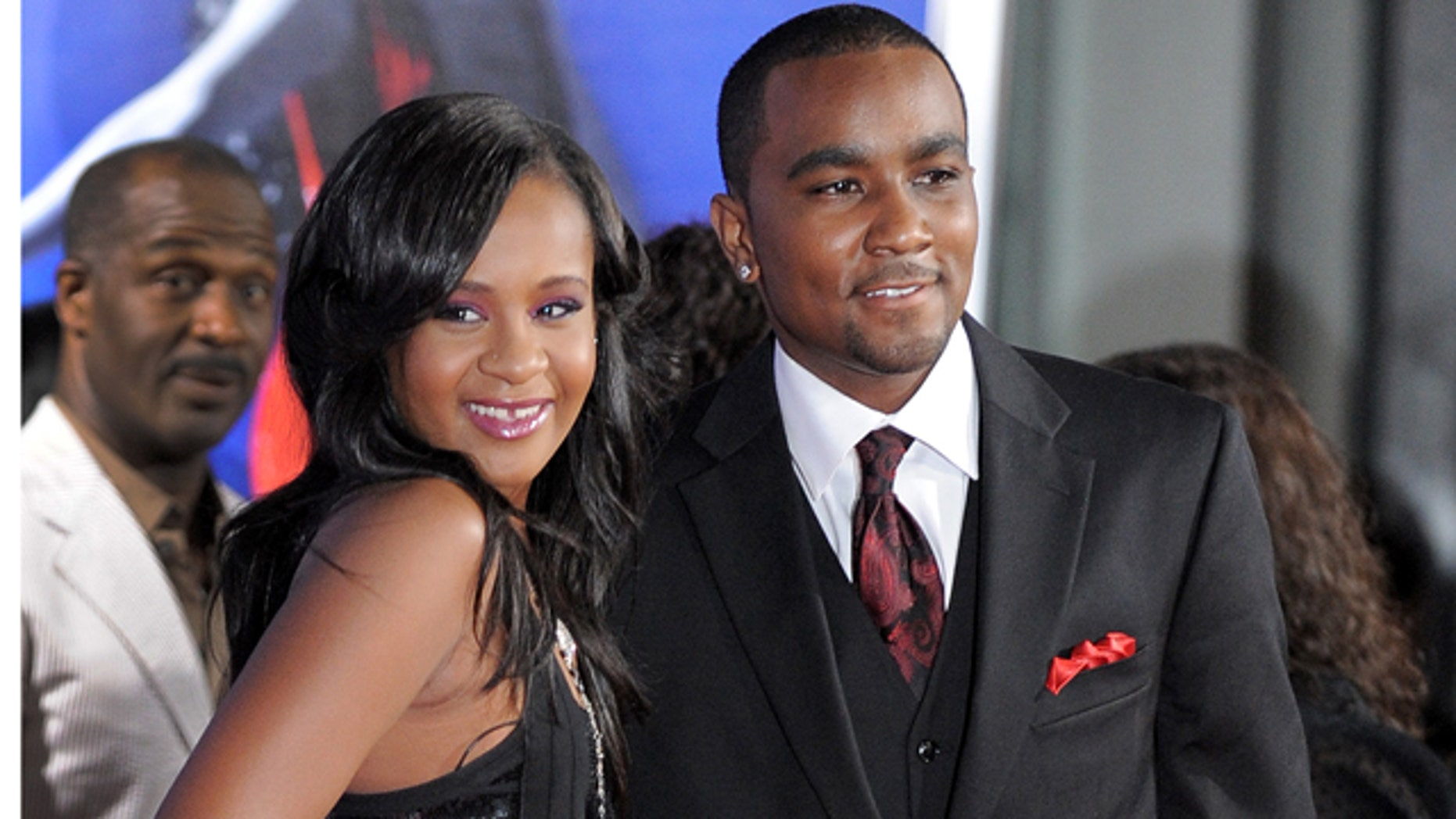FILE - In this Aug. 16, 2012, file photo, Bobbi Kristina Brown, left, and Nick Gordon attend the Los Angeles premiere of 'Sparkle' at Grauman's Chinese Theatre in Los Angeles. (Photo by Jordan Strauss/Invision/AP, File)