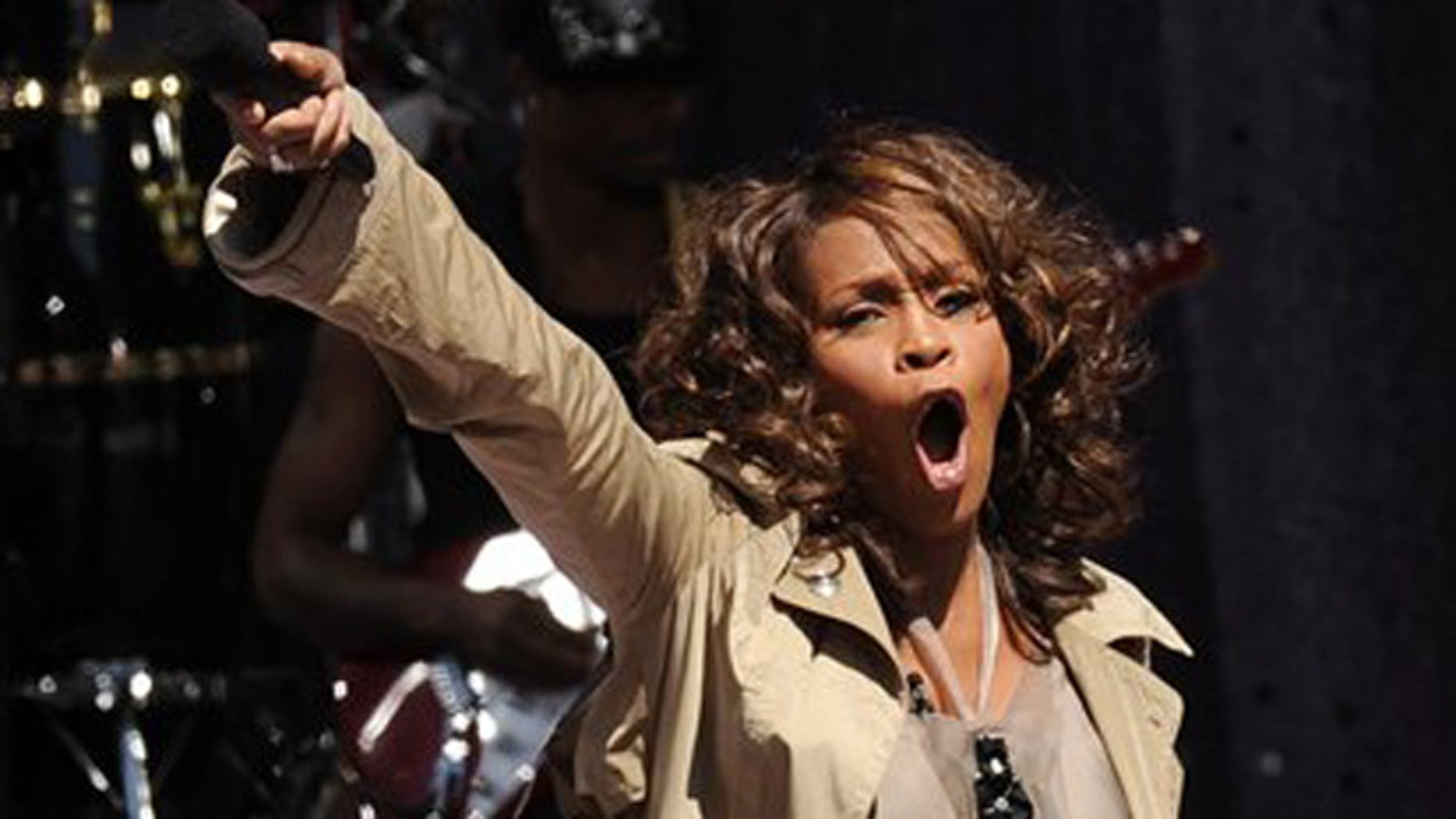 FILE - In this Sept. 1, 2009 file photo, Whitney Houston performs on 'Good Morning America' in Central Park in New York.  Whitney Houston, who reigned as pop music's queen until her majestic voice and regal image were ravaged by drug use, has died, Saturday, Feb. 11, 2012. She was 48. (AP Photo/Evan Agostini)