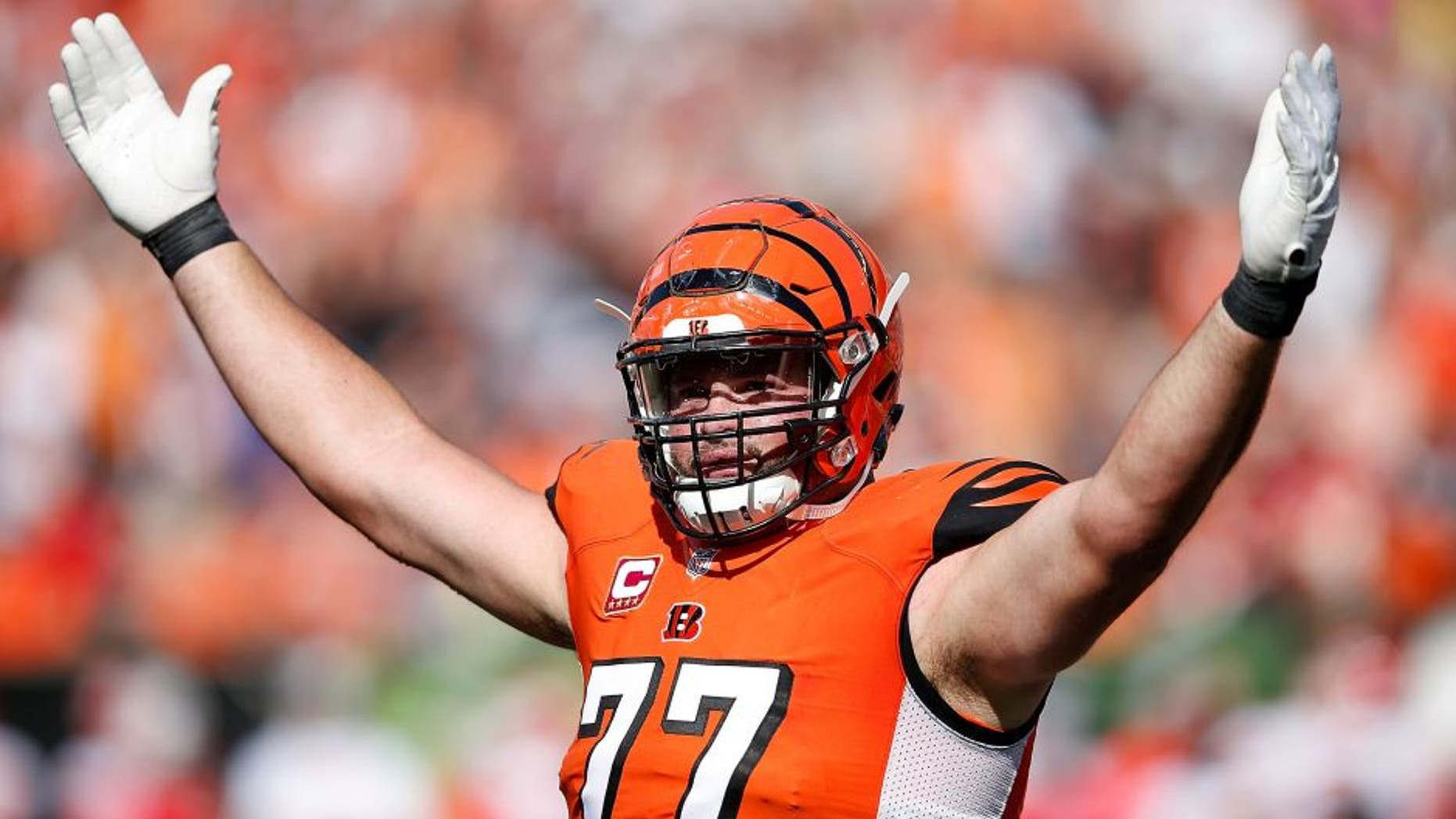 CINCINNATI, OH - OCTOBER 4: Andrew Whitworth #77 of the Cincinnati Bengals attempts to excite the crowd during the third quarter of the game against the Kansas City Chiefs at Paul Brown Stadium on October 4, 2015 in Cincinnati, Ohio. (Photo by Joe Robbins/Getty Images)