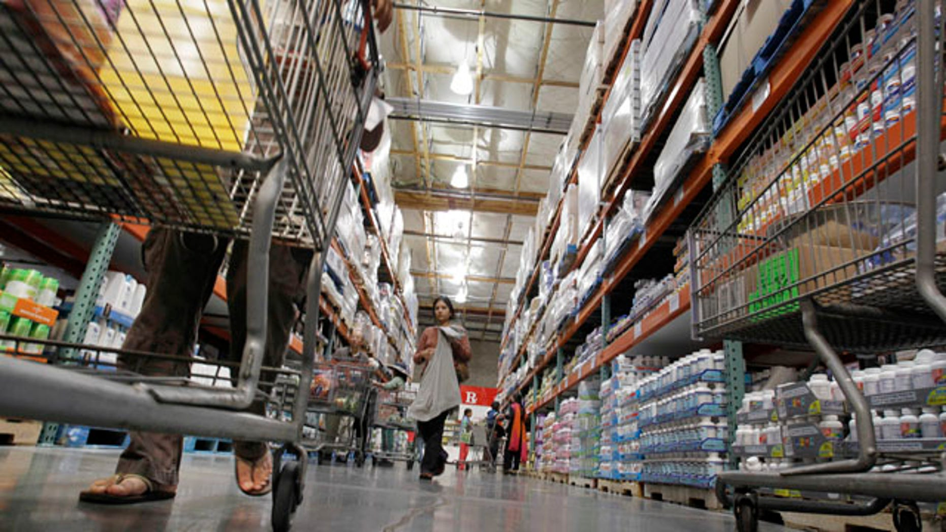 Nov. 6: Shoppers look at items at Costo in Mountain View, Calif. Inventories held at the wholesale level rose for the ninth consecutive month in September while sales rose for a third month.