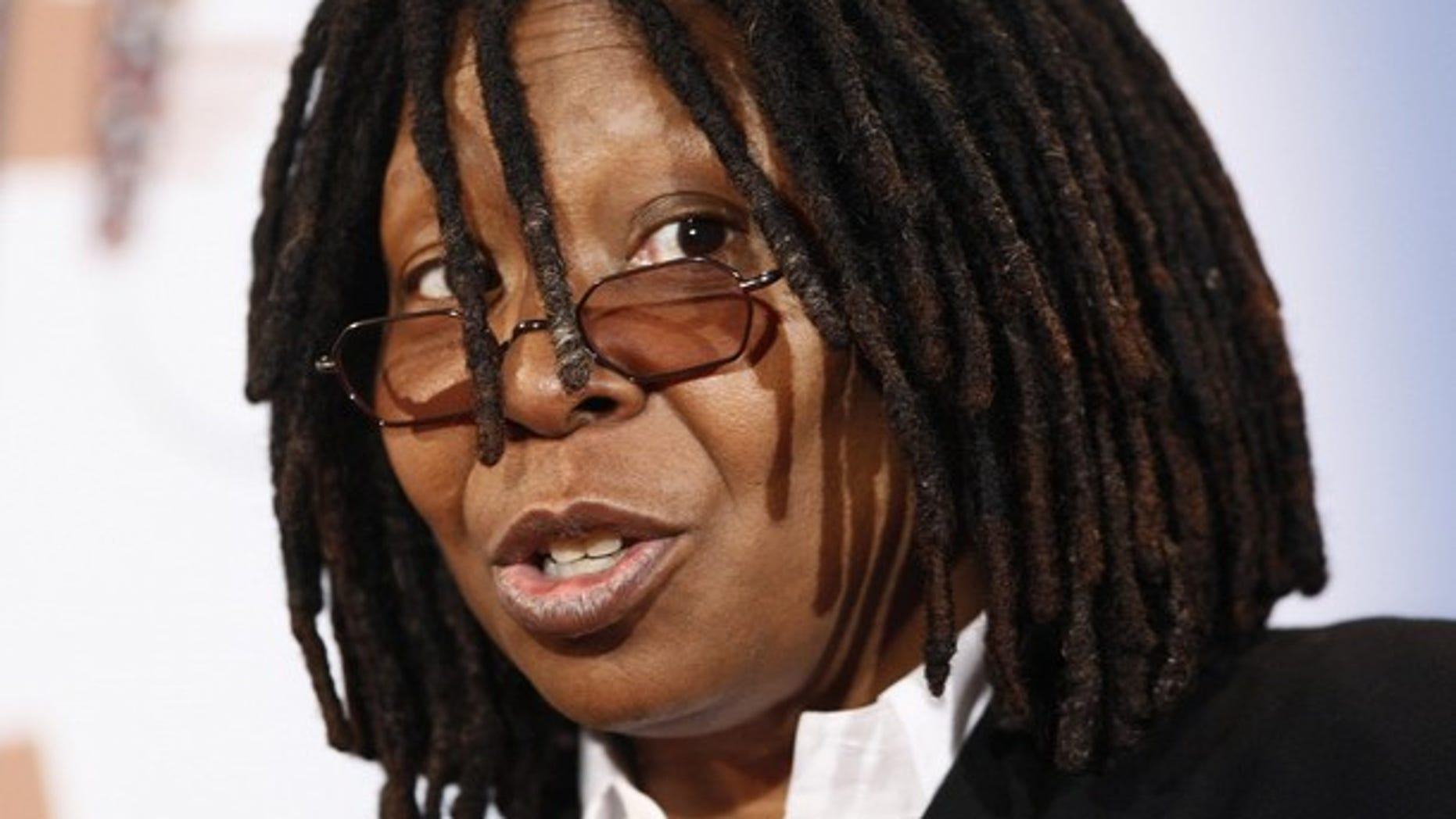 Actress and comedian Whoopi Goldberg attends a news conference to announce new musical at Operetta house in Hamburg December 4, 2009. Stage Entertainment Germany will present the famous musical 'Sister Act' at the TUI Operetta house at Hamburg's Reeperbahn from autumn 2010 on.    REUTERS/Christian Charisius  (GERMANY - Tags: ENTERTAINMENT HEADSHOT)