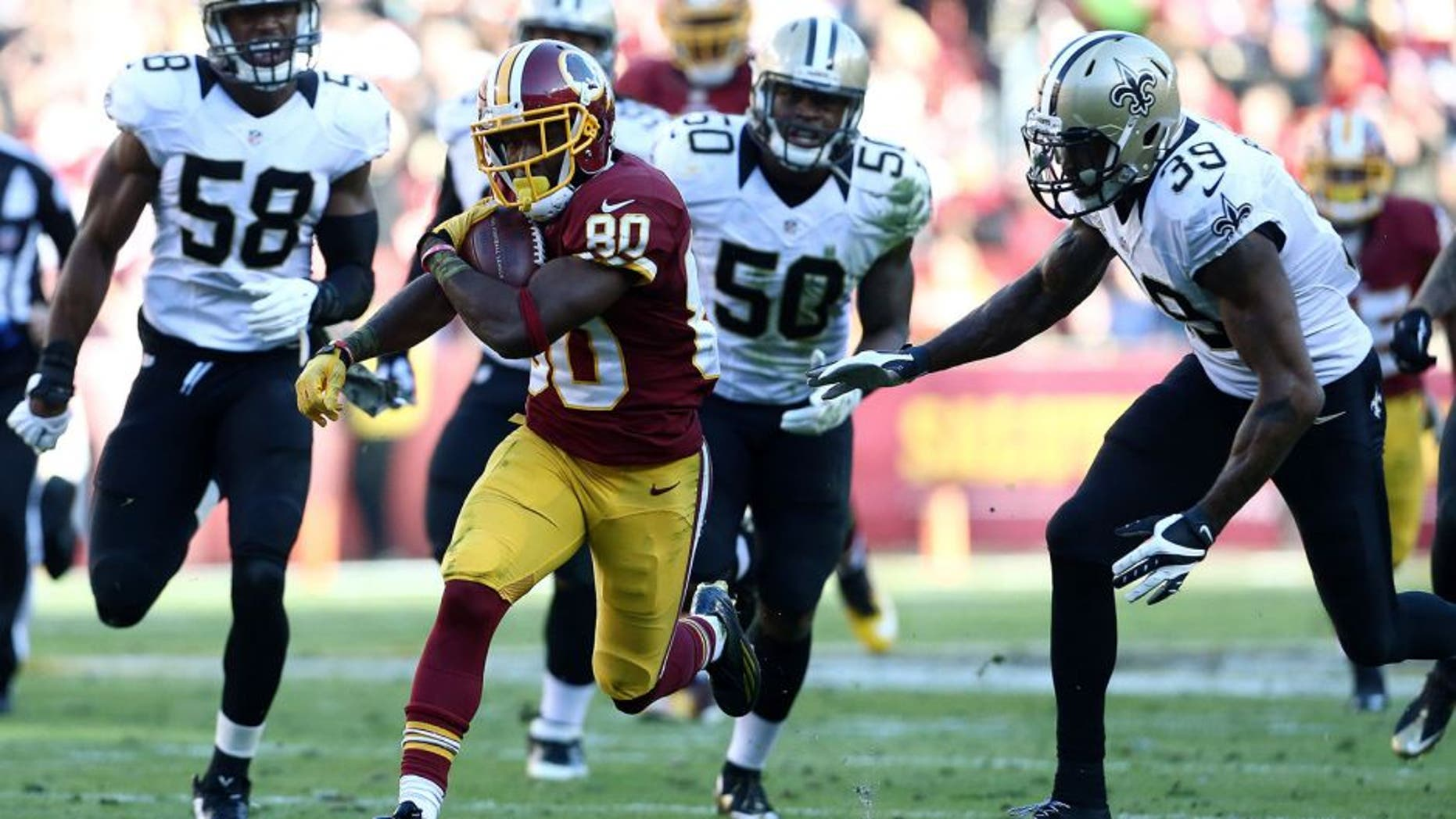 LANDOVER, MD - NOVEMBER 15: Wide receiver Jamison Crowder #80 of the Washington Redskins carries the ball past cornerback Brandon Browner #39 of the New Orleans Saints, middle linebacker Stephone Anthony #50 of the New Orleans Saints, linebacker James Anderson #58 of the New Orleans Saints in the second quarter of a game at FedExField on November 15, 2015 in Landover, Maryland. (Photo by Matt Hazlett/Getty Images)