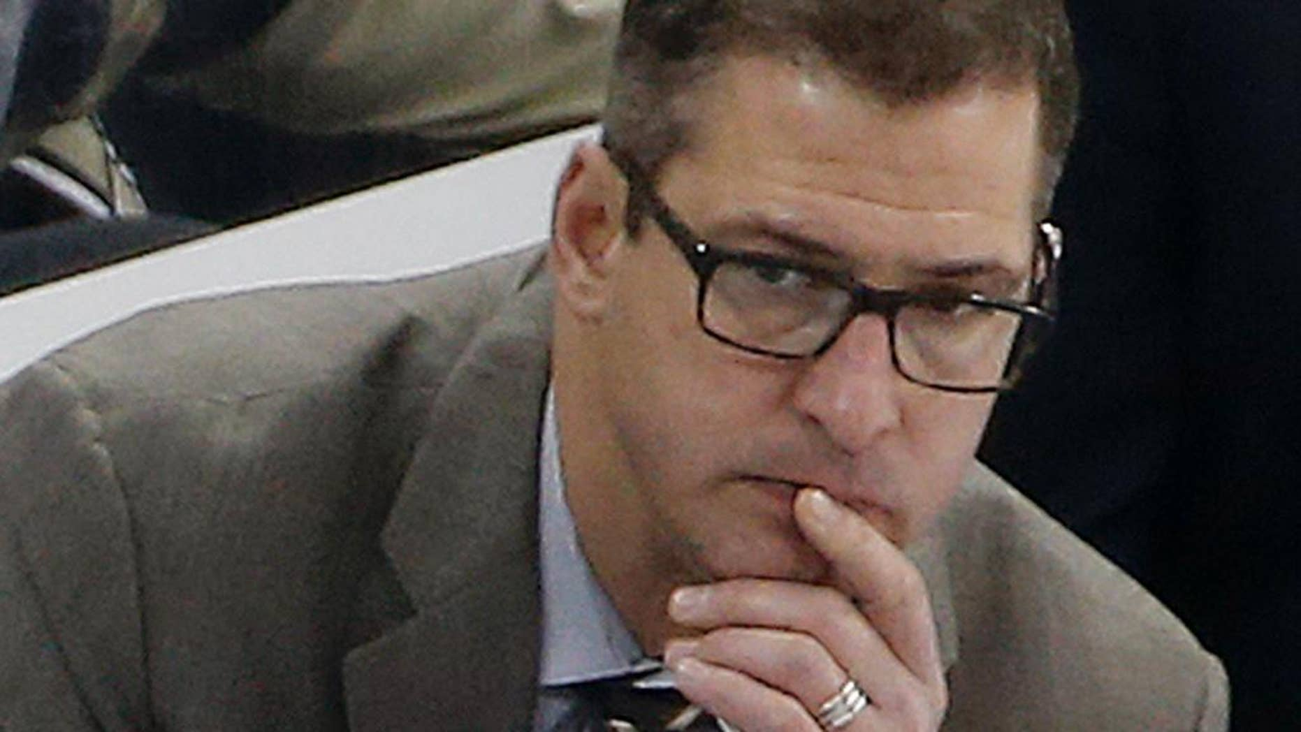 FILE-  In this Jan. 13, 2015, file photo, Minnesota Wild assistant coach Darryl Sydor, shown during an NHL hockey game in Pittsburgh, has been charged with drunken driving after being arrested while taking his 12-year-old son to a hockey game. He has been an assistant coach for the past four seasons and also played 18 seasons in the NHL. (AP Photo/Gene J. Puskar,File)