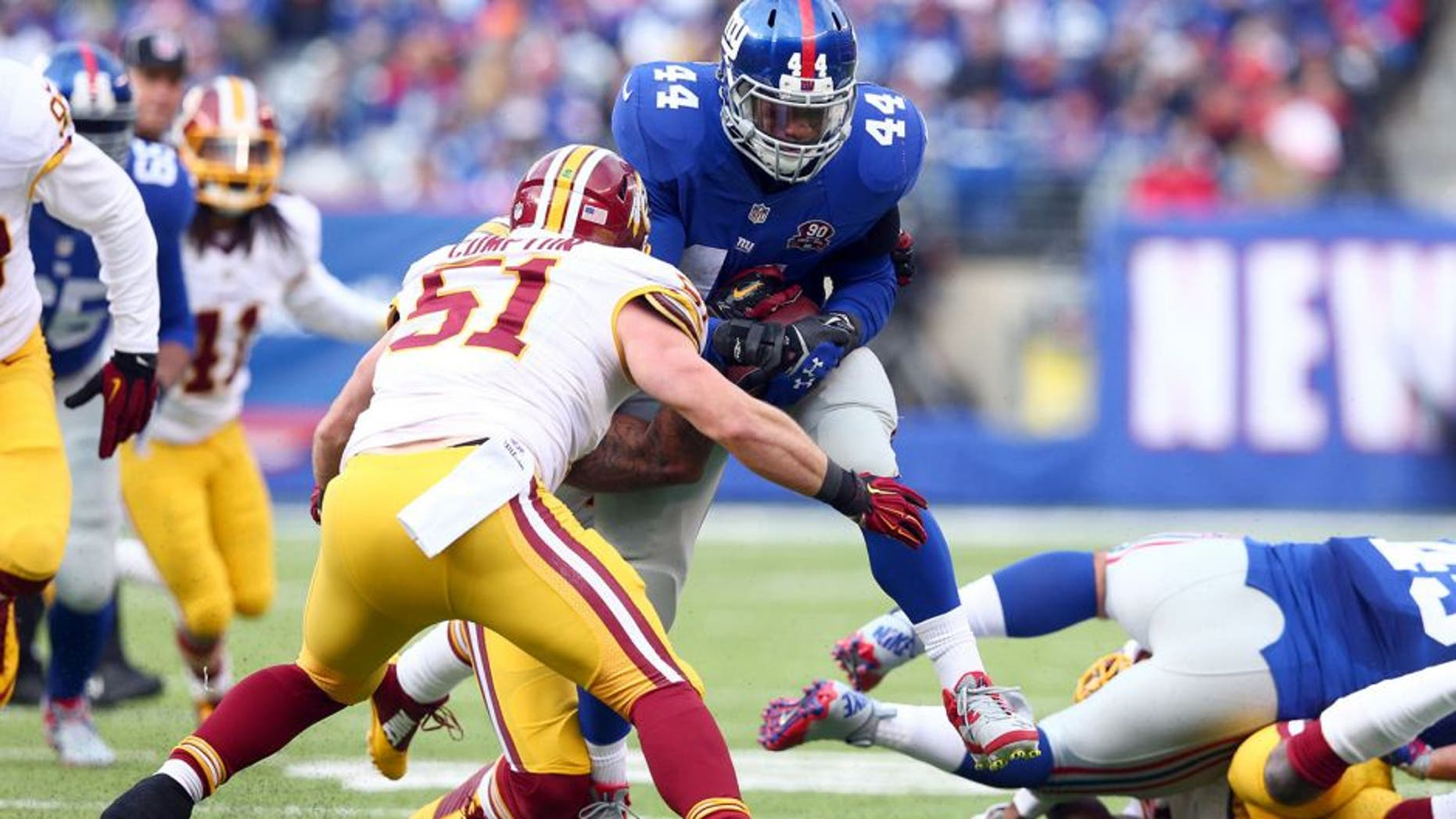 Dec 14, 2014; East Rutherford, NJ, USA; New York Giants running back Andre Williams (44) carries against Washington Redskins inside linebacker Will Compton (51) during the first quarter of a game at MetLife Stadium. Mandatory Credit: Brad Penner-USA TODAY Sports