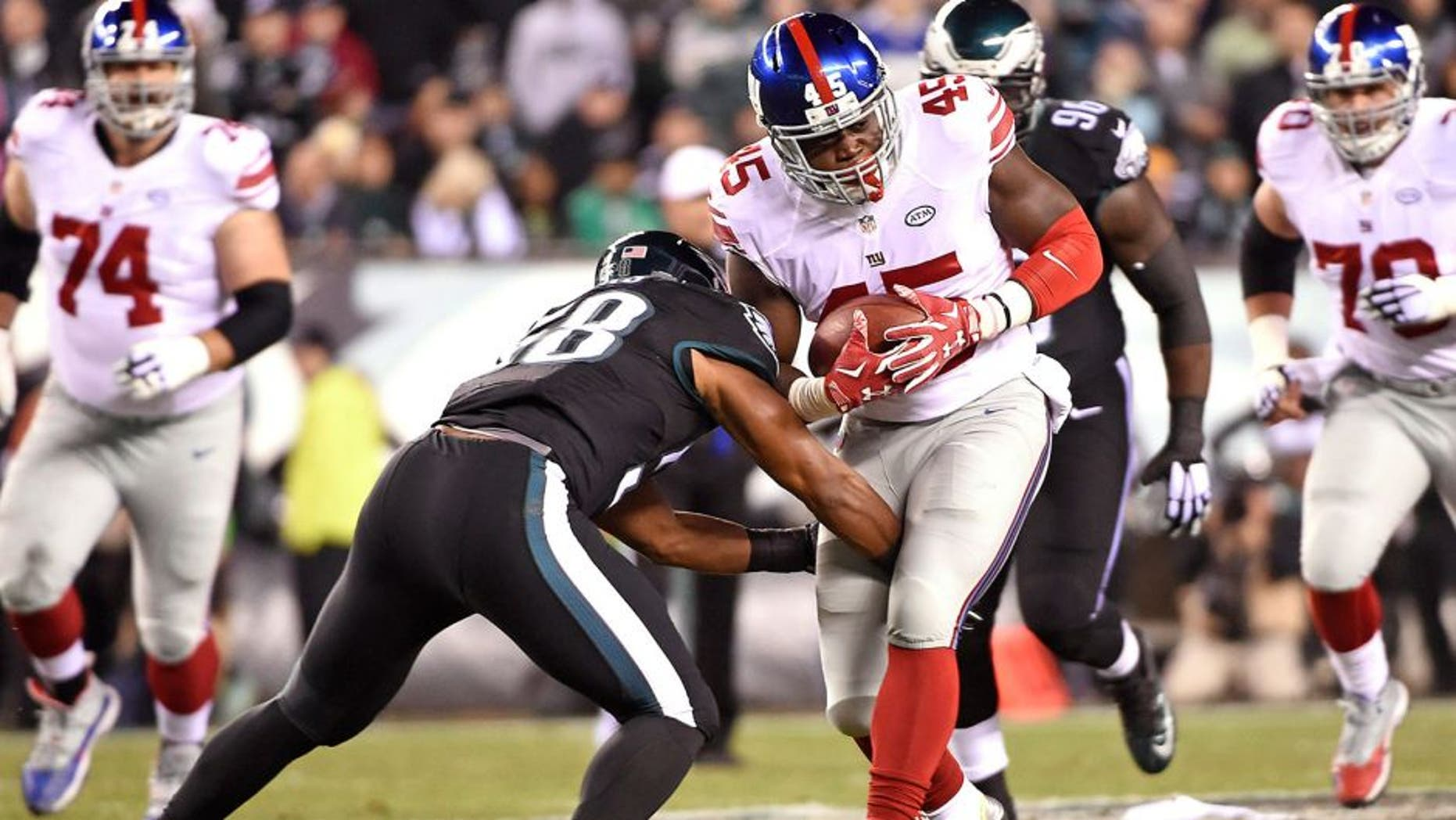 Oct 19, 2015; Philadelphia, PA, USA; New York Giants tight end Will Tye (45) is tackled by Philadelphia Eagles outside linebacker Jordan Hicks (58) during the first quarter at Lincoln Financial Field. Mandatory Credit: Eric Hartline-USA TODAY Sports