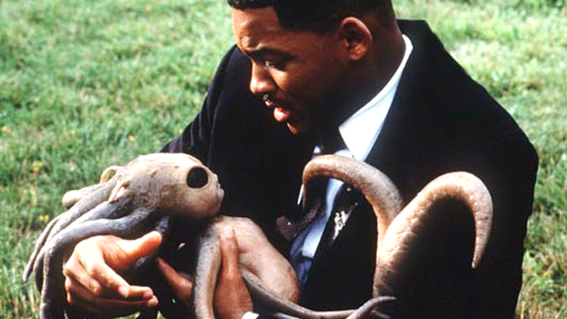 "Will Smith delivered an alien baby in the movie ""Men in Black."" But would he baptize it?"