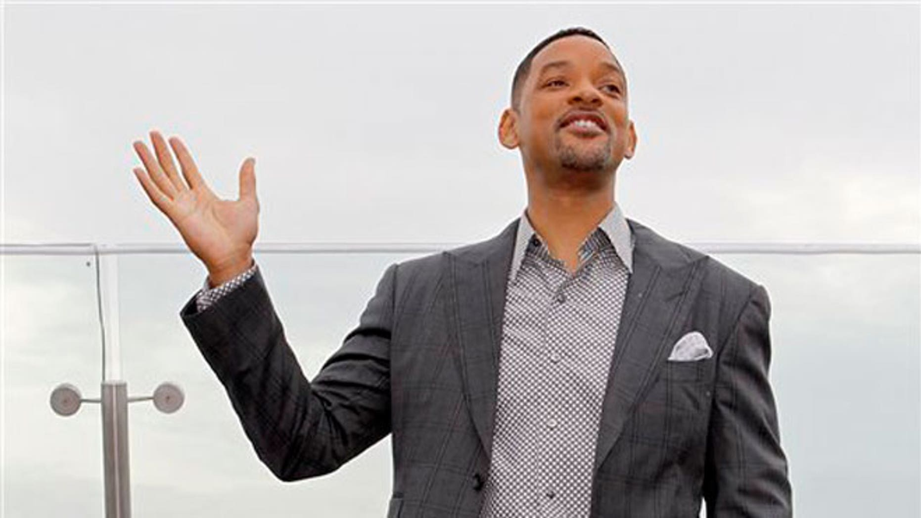 """May 18: Will Smith poses for photographers at a hotel during a photocall for his film """"Men in Black 3"""" in Moscow, Russia."""