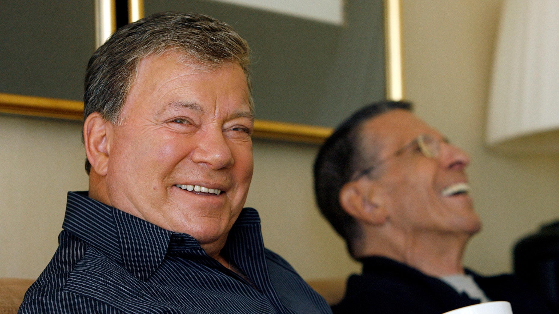 Actors William Shatner  and Leonard Nimoy laugh during an interview for the 40th anniversary of the science-fiction television series 'Star Trek' in Los Angeles August 9, 2006.