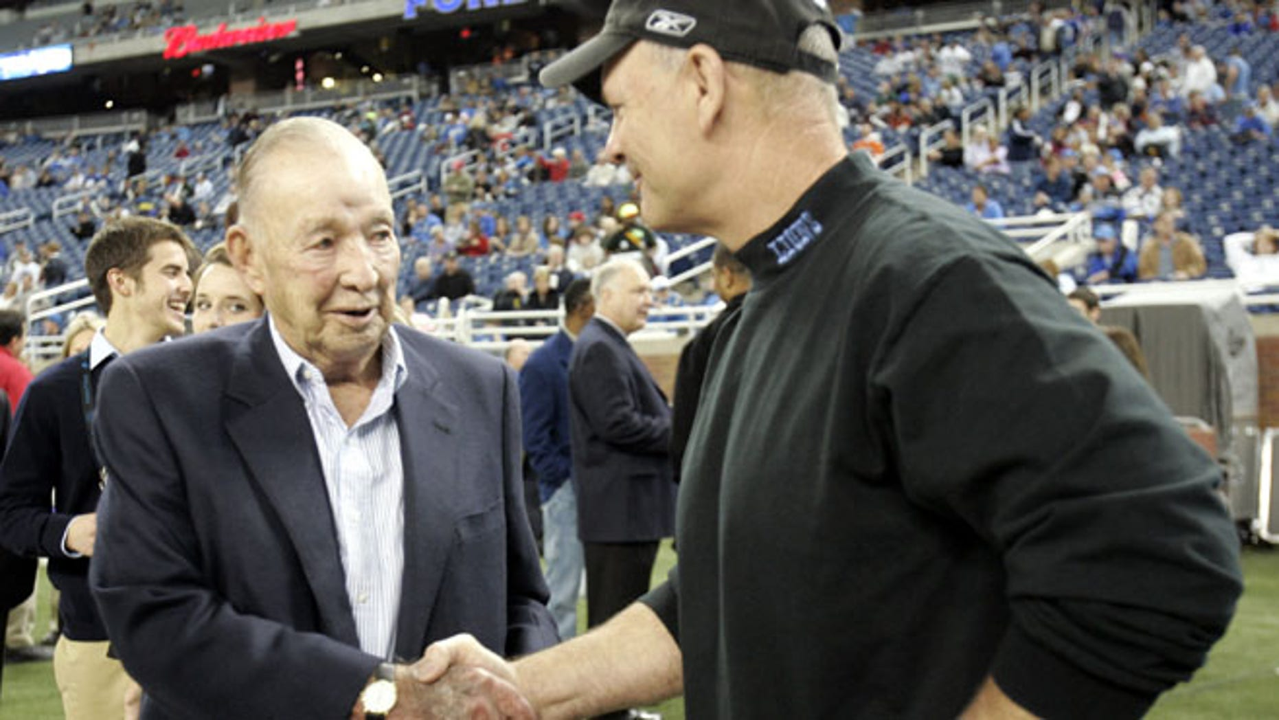 Detroit Lions team owner William Clay Ford Sr. (L) shakes hands with Lions head coach Rod Marinelli before the start of their NFL football game against the New York Giants in Detroit, Michgan November 18, 2007.  REUTERS/Rebecca Cook  (UNITED STATES) - RTX33KD