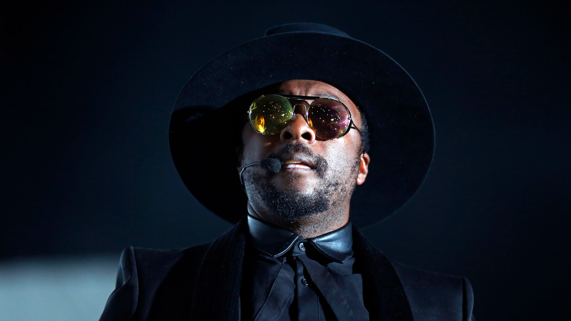 Recording artist Will.i.am performs at Bercy stadium in Paris, December 16, 2013.