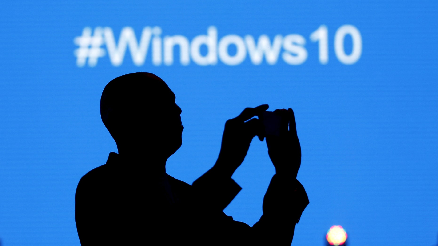 File print - A Microsoft nominee takes a design during a launch of a Windows 10 handling complement in Kenya's collateral Nairobi, Jul 29, 2015.