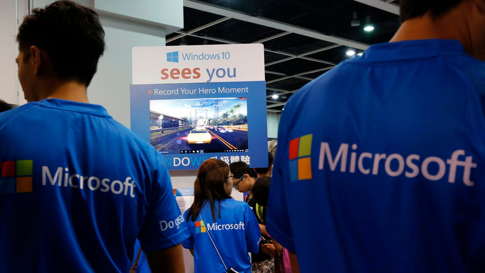 Promotional staff stand at the Microsoft Windows 10 booth two days before its global official launch at the Ani-Com & Games Hong Kong in Hong Kong, China, July 27, 2015.