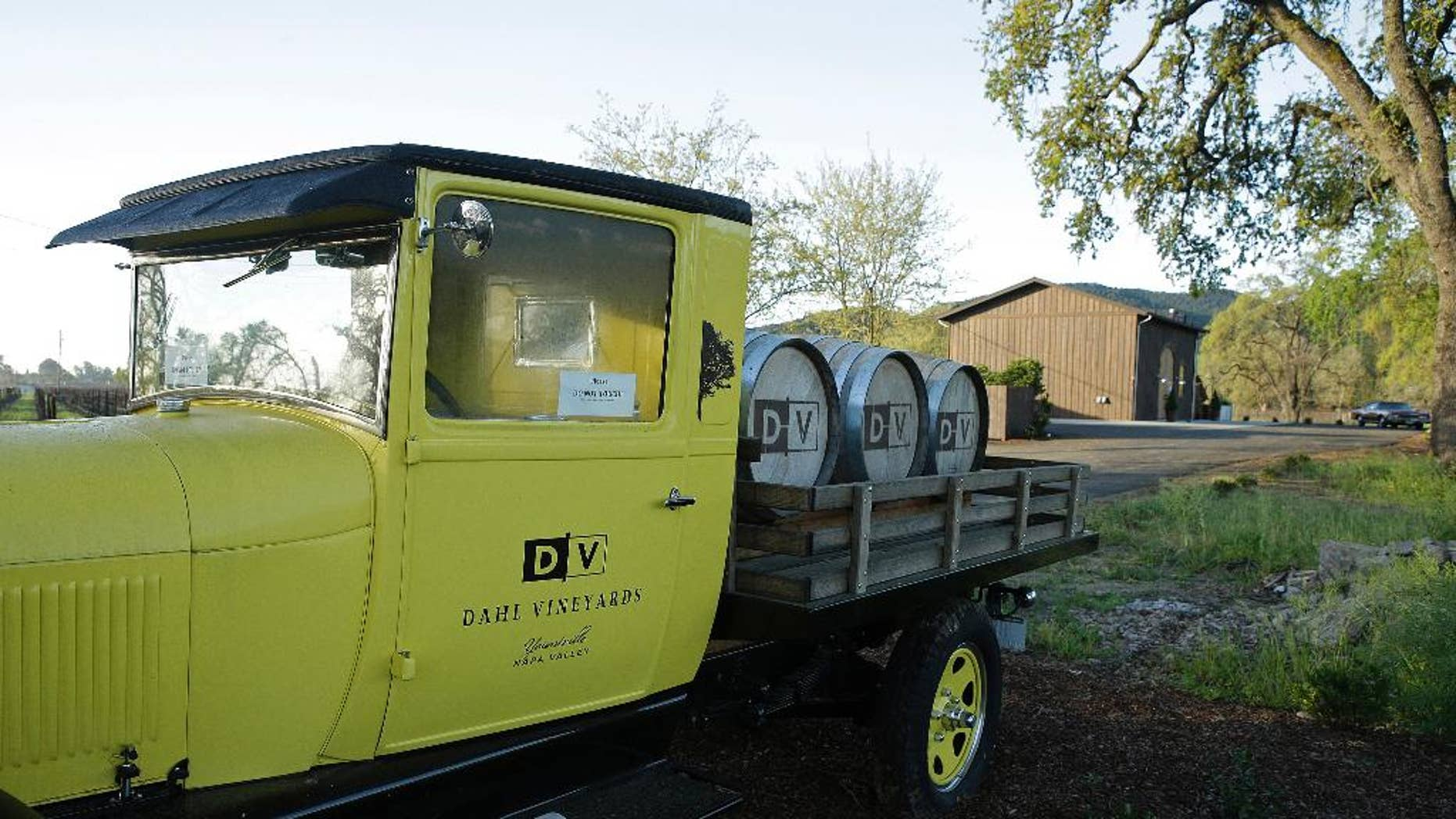 FILE - In this March 18, 2015 file photo, a 1926 Model T Ford truck is parked at the entrance to Dahl Vineyards in Yountville, Calif. A police dispatcher told police that a man later identified as a Silicon Valley investor had been shot and wounded while an assailant chased him through a California vineyard, according to the 911 recordings released Tuesday, March 24, 2015. The tapes show police arrived at Dahl Vineyards shortly before noon, four minutes after the initial 911 call and just moments before authorities say vintner Robert Dahl shot Emad Tawfilis in the head at close range. Tawfilis died at the scene. Dahl then led police on a brief, high-speed chase through Napa Valley wine country before stopping and committing suicide with a shot to the head. (AP Photo/Eric Risberg, File)