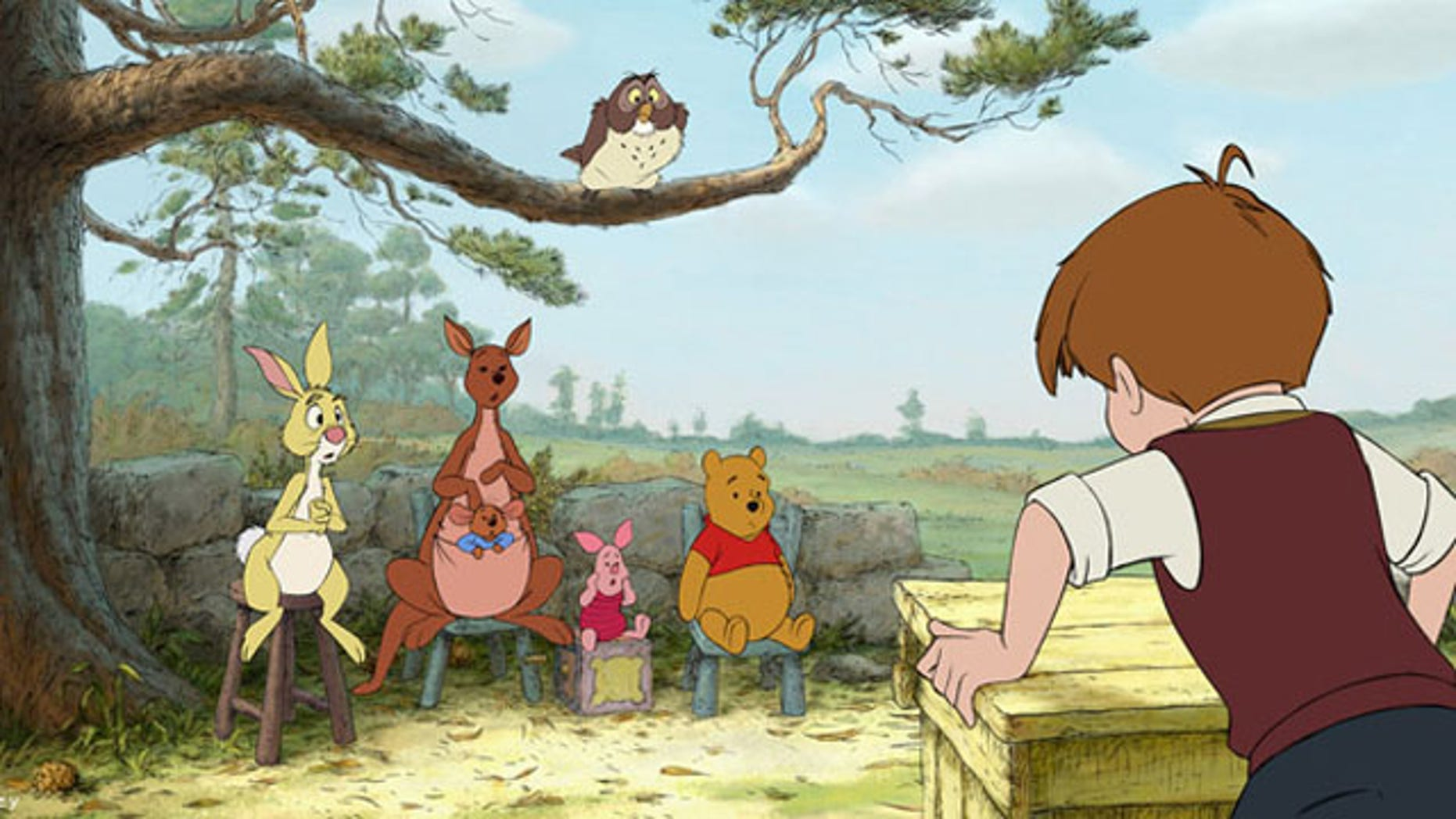 """In a scene from """"Winnie the Pooh,"""" characters from left, Rabbit, Kanga, Roo, Piglet, Owl, Winnie the Pooh and Christopher Robin."""