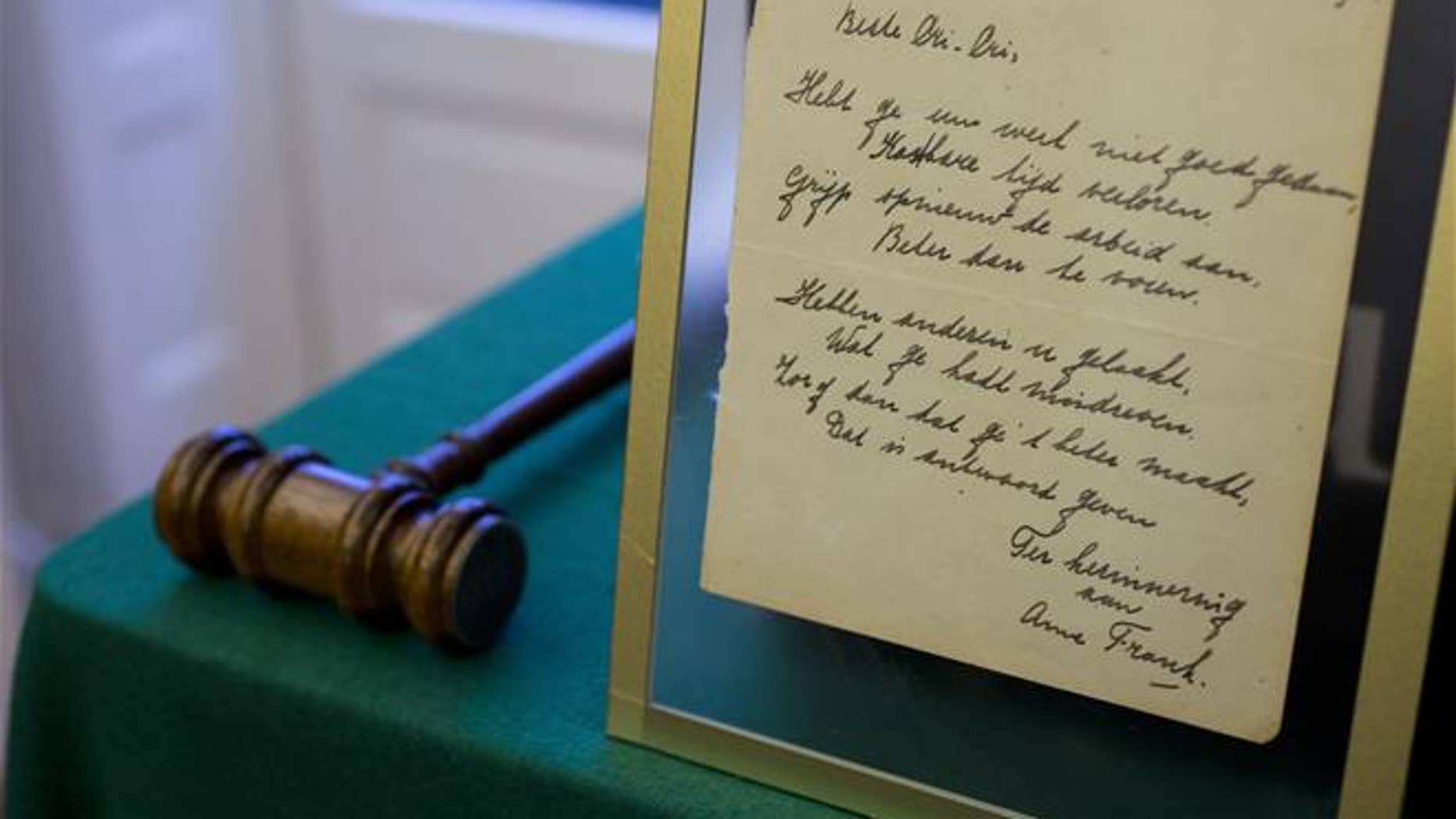 A short poem by Anne Frank is displayed at Bubb Kuyper auction house.