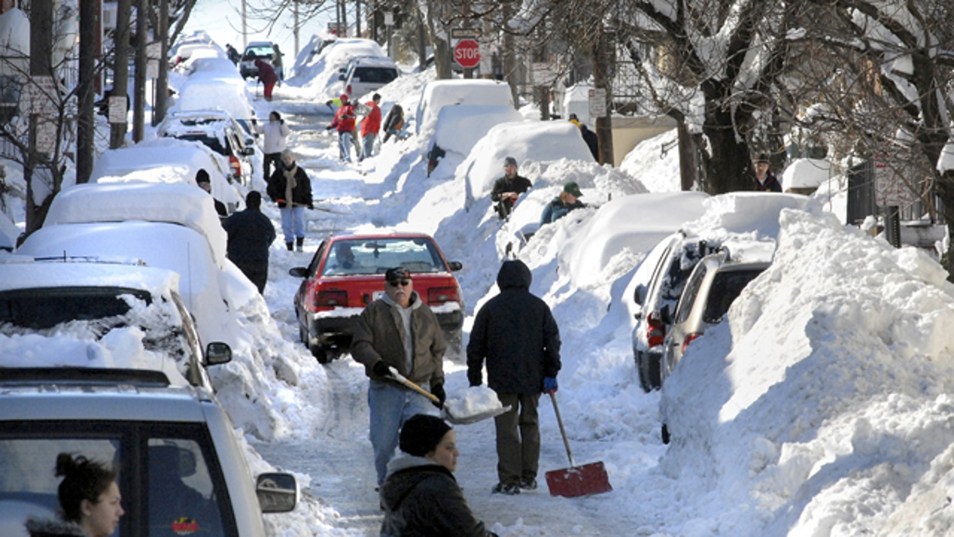 As snow-weary Pennsylvanians dug out, utilities struggled to restore power to thousands and crews worked to reopen closed roads after a record-breaking blizzard that dumped more than a foot of snow across the state.