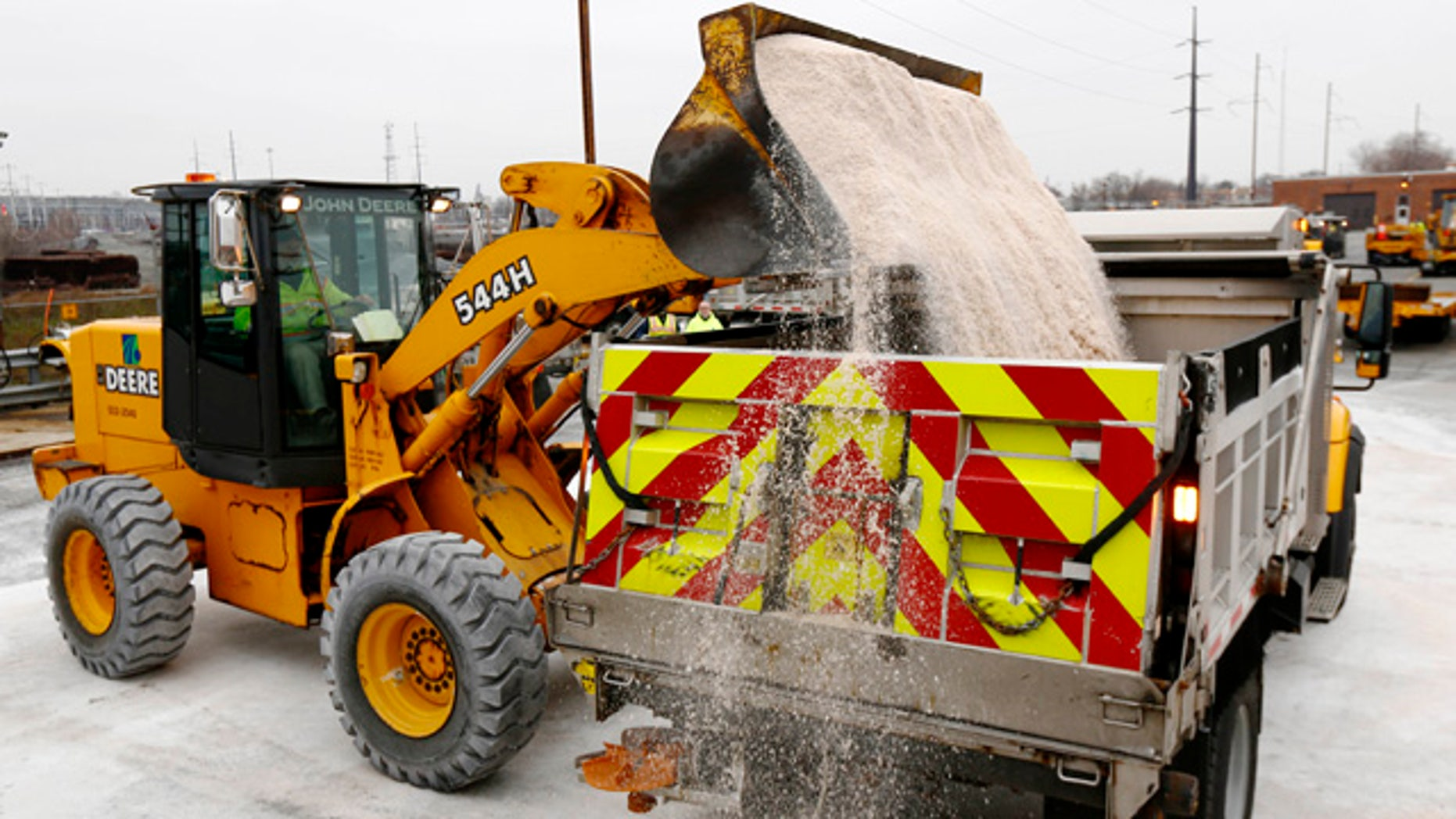 Jan. 2, 2014: A worker at the Pennsylvania Department of Transportation facility dumps salt into a truck as they make preparations for an expected winter storm.