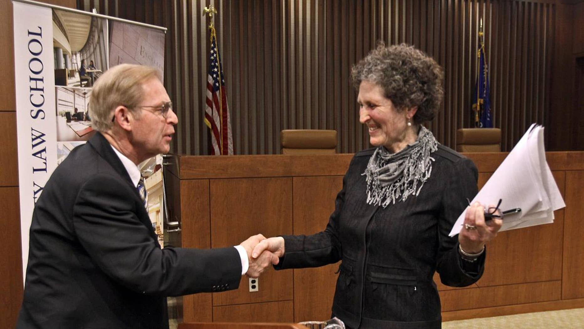 Justice David Prosser shakes hands with Assistant Attorney General JoAnne Kloppenburg after their debate for the Wisconsin Supreme Court at the Marquette University Law School in Milwaukee. (AP Photo/Milwaukee Journal-Sentinel, Benny Sieu)