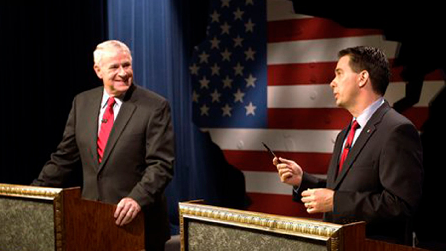 May 25, 2012: Wisconsin GOP Gov. Scott Walker, right, and Democratic challenger Tom Barrett get ready to participate in a televised debate.