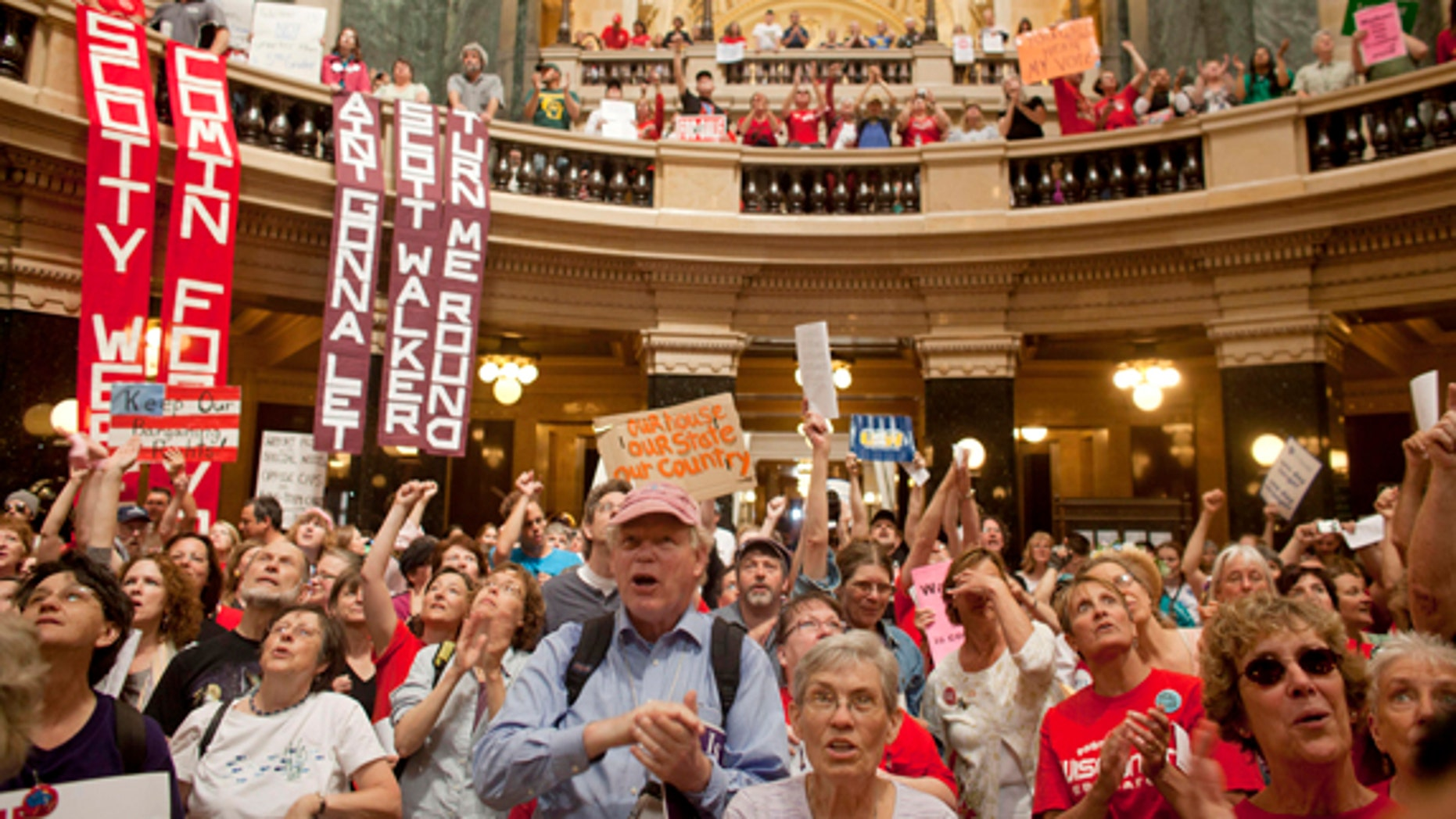 FILE: June 14, 2011: Protesters, including supporters of public employee unions, at the State Capitol Building, in Milwaukee, Wisc.