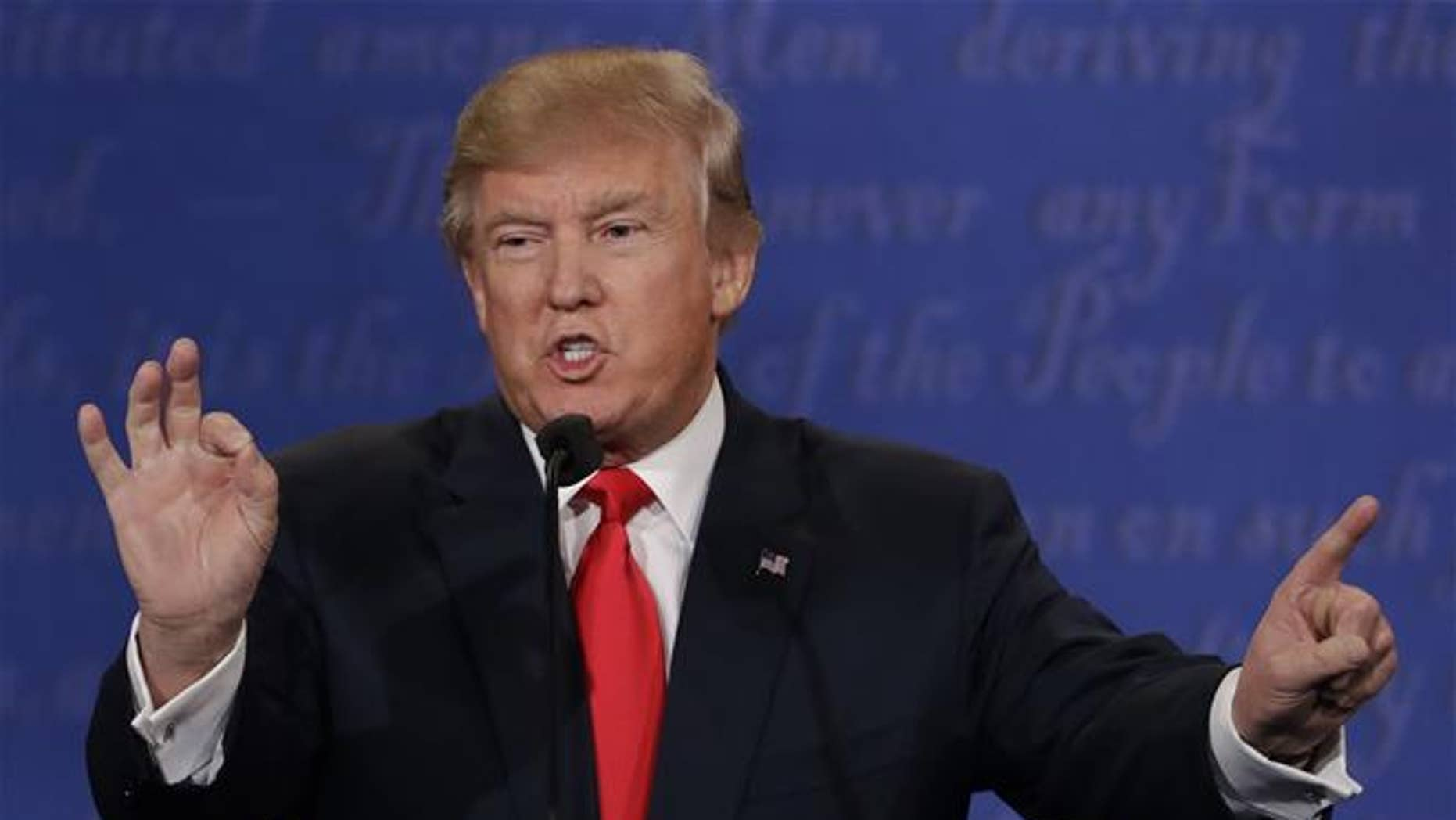 In this Oct. 19, 2016 file photo, Republican presidential nominee Donald Trump speaks during the third presidential debate with Democratic presidential nominee Hillary Clinton at UNLV in Las Vegas. Trump last spring pledged that he would act perfectly presidential when the time was right.