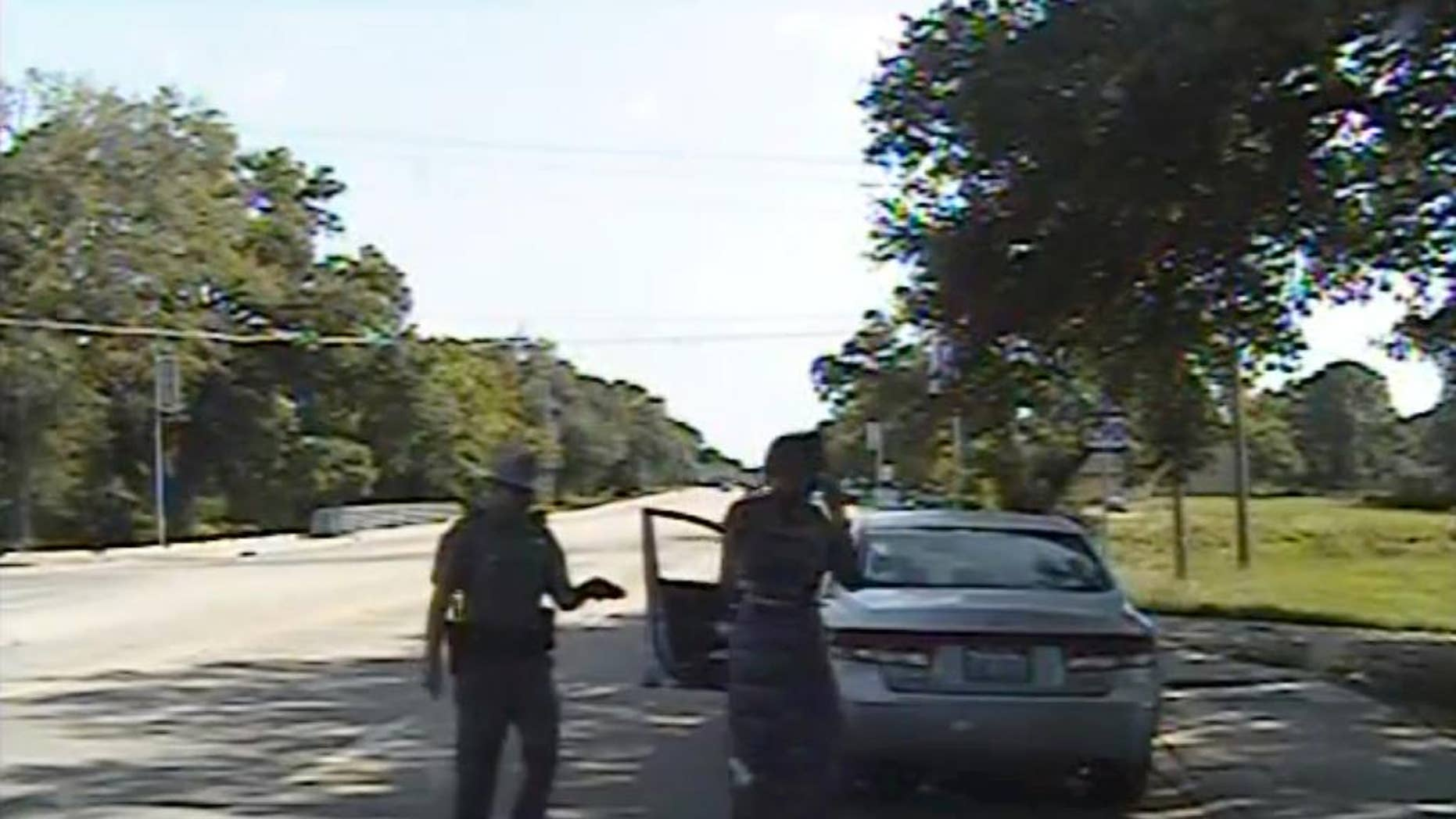 """FILE- In this July 10, 2015 file frame from dashcam video provided by the Texas Department of Public Safety, trooper Brian Encinia arrests Sandra Bland after she became combative during a routine traffic stop in Waller County, Texas. Encinia, a Texas trooper who arrested Bland after a confrontation that began with a traffic stop, had been cautioned about """"unprofessional conduct"""" in a 2014 incident while he was still a probationary trooper. (Texas Department of Public Safety via AP, File)"""