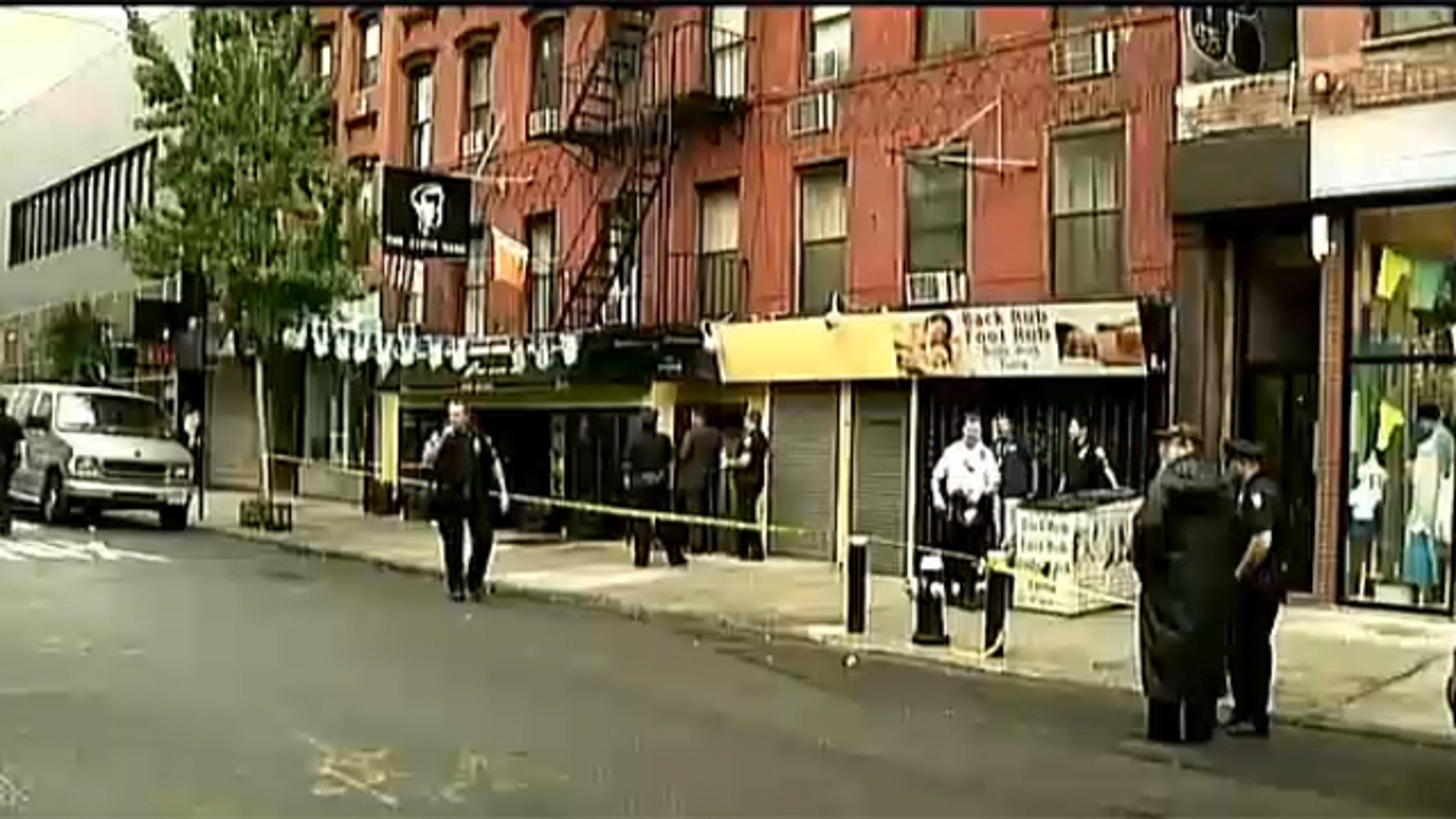 Aug. 27, 2012: Investigators work outside apartment building where woman found dead.