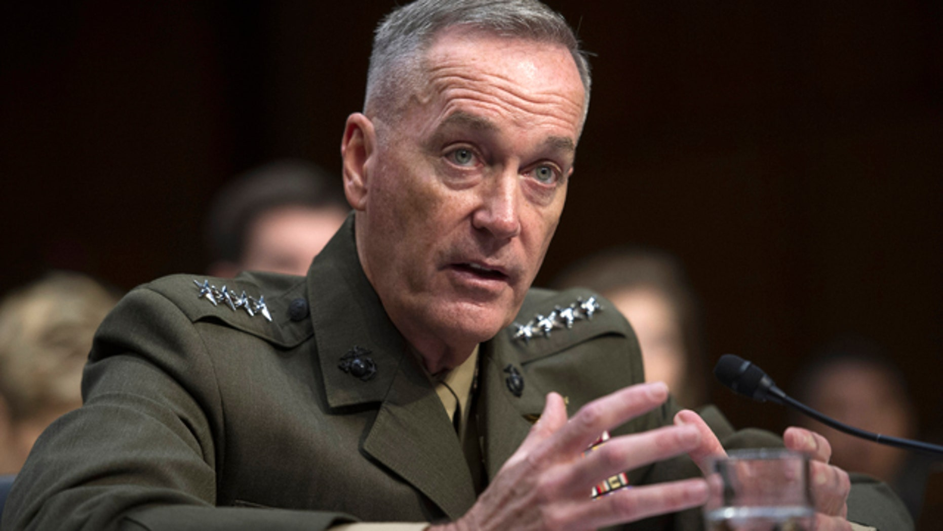 FILE - In this July 9, 2015, file photo, then-Marine Corps Commandant Gen. Joseph Dunford, Jr., testifies during his Senate Armed Services Committee confirmation hearing to become the Chairman of the Joint Chiefs of Staff, on Capitol Hill in Washington. (AP Photo/Cliff Owen, File)