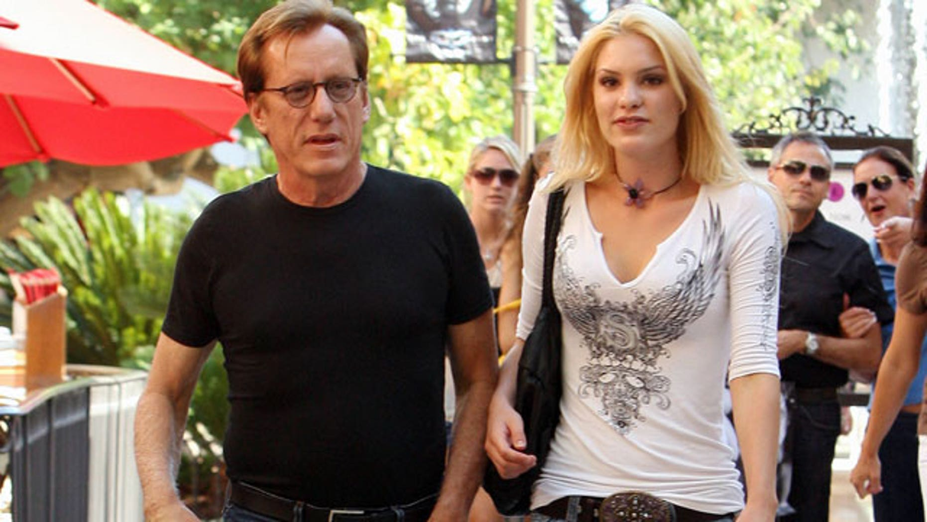 Actor James Woods, seen with Ashley Madison Myrick