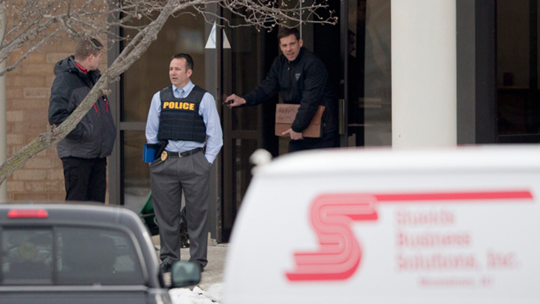 Feb. 23, 2015: Investigators stand at the scene of a shooting at a Shields Business Solutions office in Moorestown, N.J. (AP)