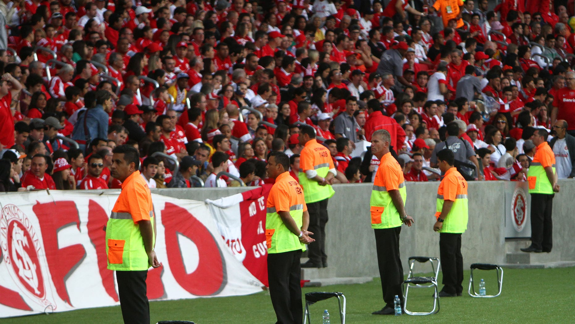 PORTO ALEGRE, BRAZIL - MAY 10:  Stewards looks on Internacional fans before match between Internacional and Atletico-PR as part of Brasileirao Series A 2014 in Beira-Rio Stadium on May 10, 2014, in Porto Alegre, Brazil. This match is one of the test events for FIFA 2014 World Cup which Beira-Rio will host five games. (Photo by Lucas Uebel/Getty Images)