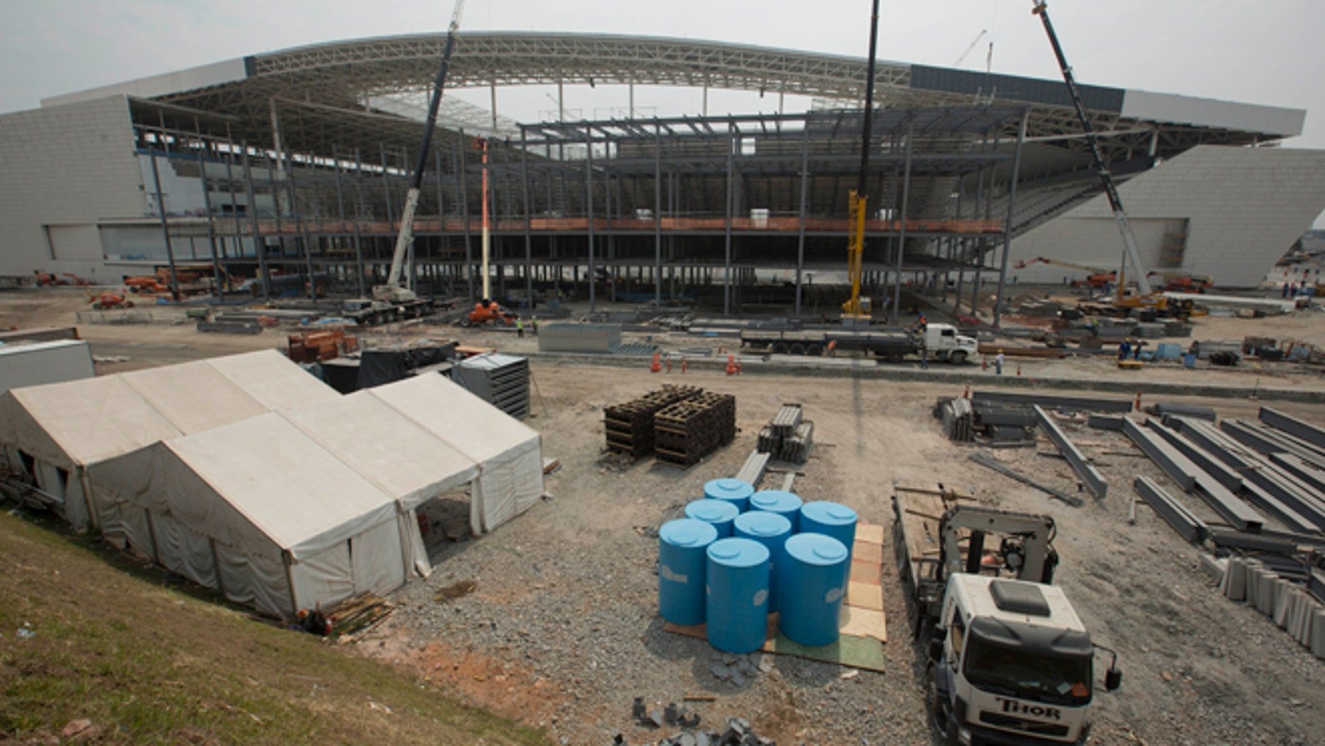 FILE - This April 9, 2014 file photo shows construction at the Itaquerao stadium in Sao Paulo, Brazil. The stadium is slated to host the World Cup opener match between Brazil and Croatia on June 12. About 20,000 temporary seats are being installed behind the goals to increase the stadium's capacity to nearly 70,000.  (AP Photo/Andre Penner, FIle)
