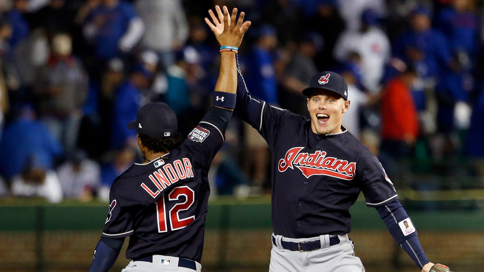 Cleveland Indians' Brandon Guyer, right, celebrates with Francisco Lindor (12) after Game 4 of the Major League Baseball World Series against the Chicago Cubs, Saturday, Oct. 29, 2016, in Chicago. The Indians won 7-2 to take a 3-1 lead in the series. (AP Photo/Nam Y. Huh)
