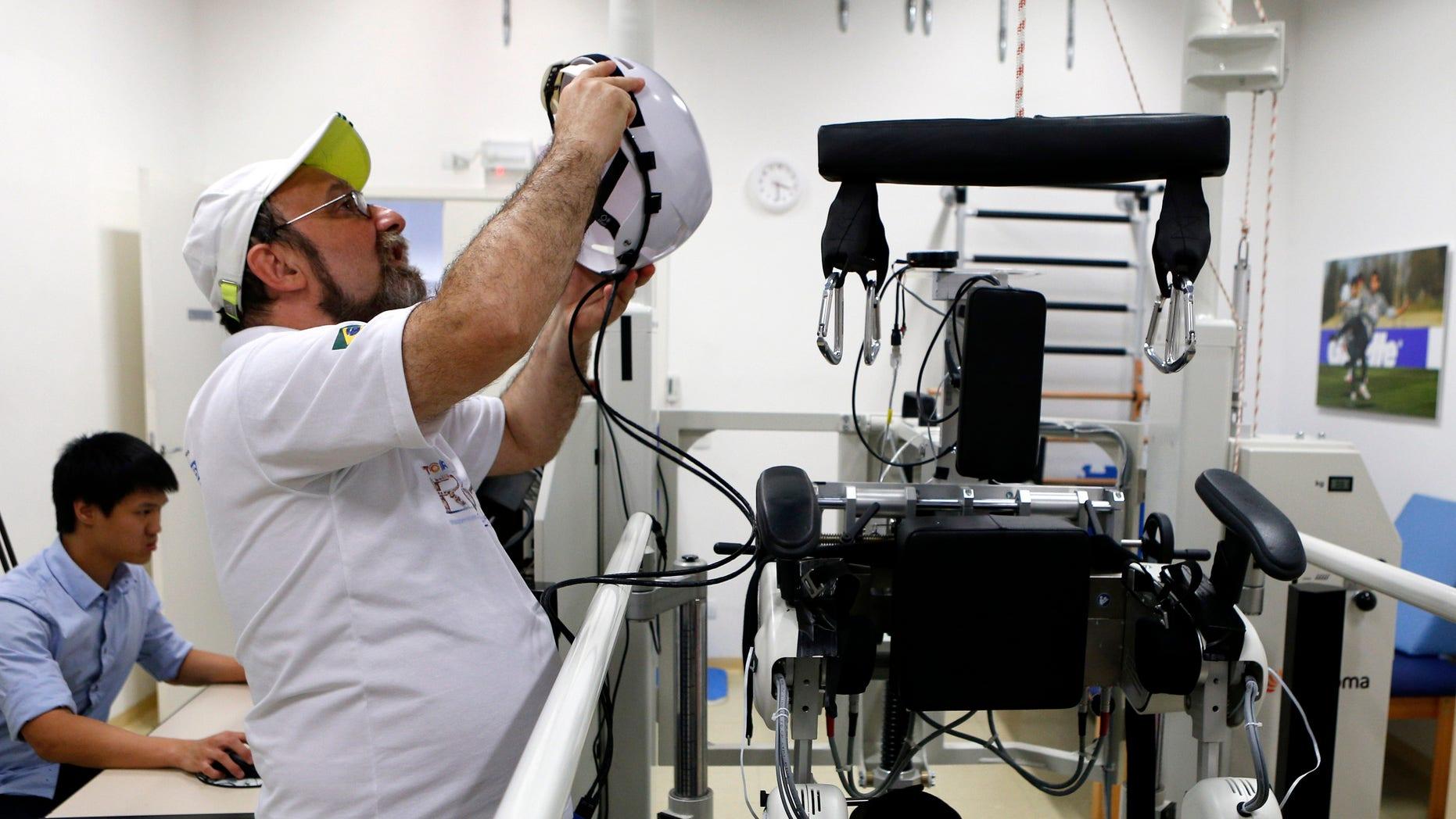 Brazilian neuroscientist Miguel Nicolelis works in his robotic laboratory in Sao Paulo May 21, 2014. (REUTERS/Paulo Whitaker)